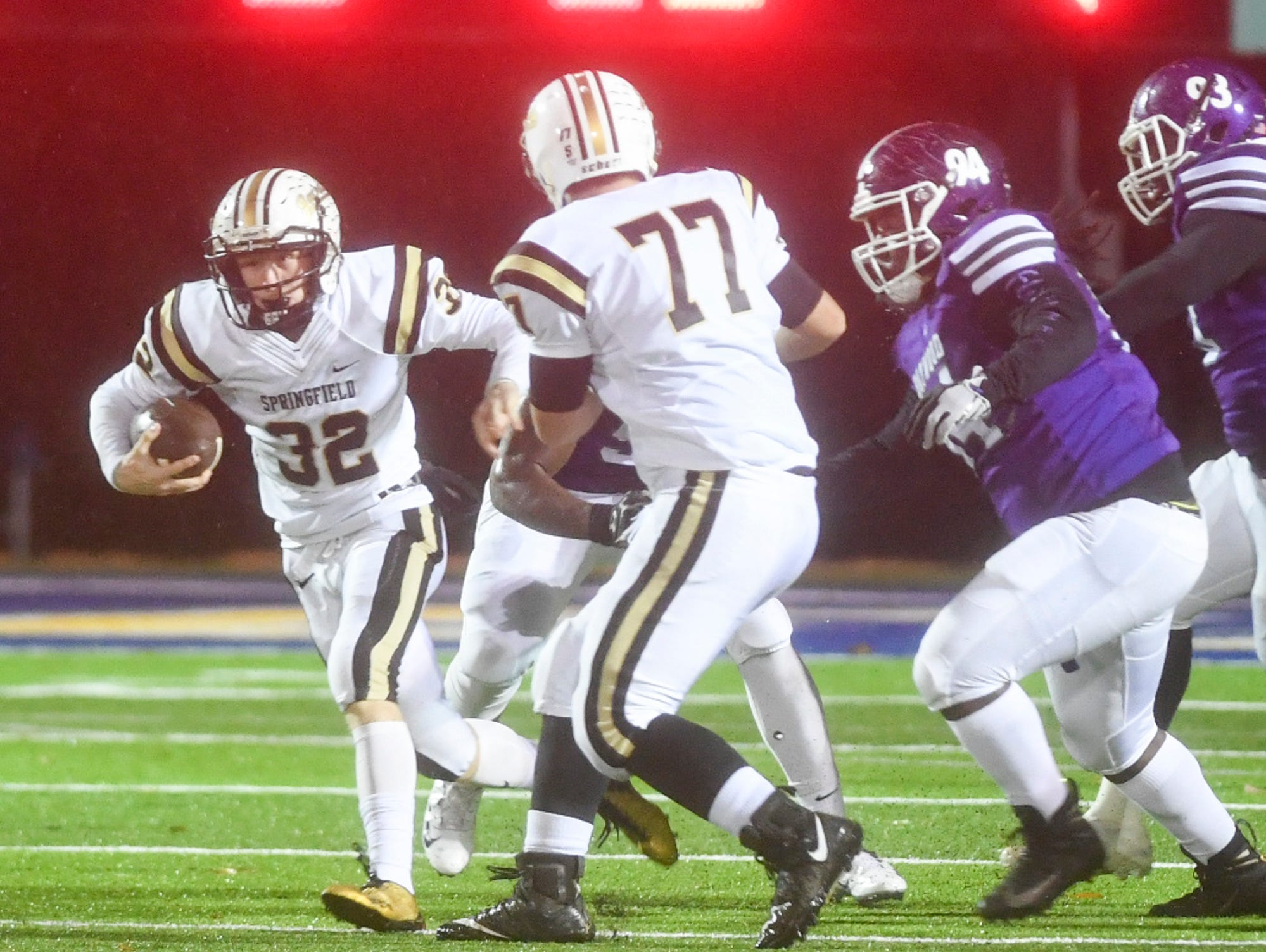 Springfield's Bryan Hayes runs the ball in attempt to avoid Haywood defenders during their Class 4A semifinal game, Friday, November 23. Haywood defeated Springfield, 49-14.