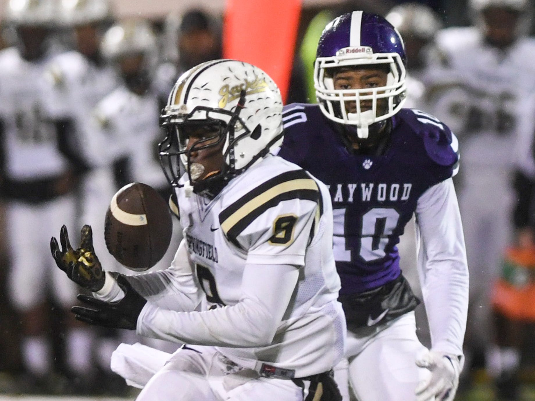 Springfield's Keith Jones makes a catch before being brought down by Haywood's Taylor Shields during their Class 4A semifinal game, Friday, November 23. Haywood defeated Springfield, 49-14.