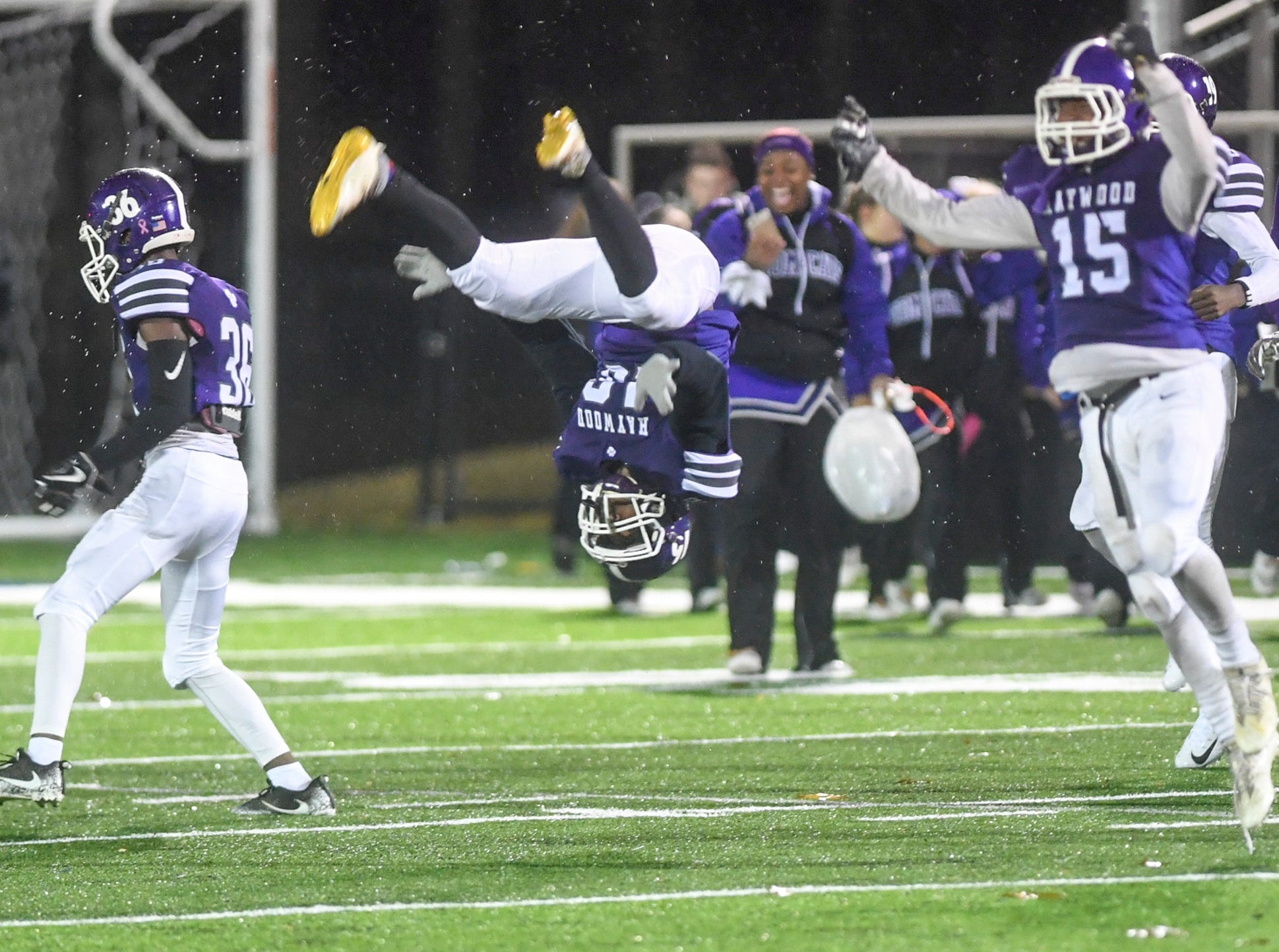 Haywood's Hollis Lanier turns a backflip after Haywood defeated Springfield, 49-14, during their Class 4A semifinal game, Friday, November 23.