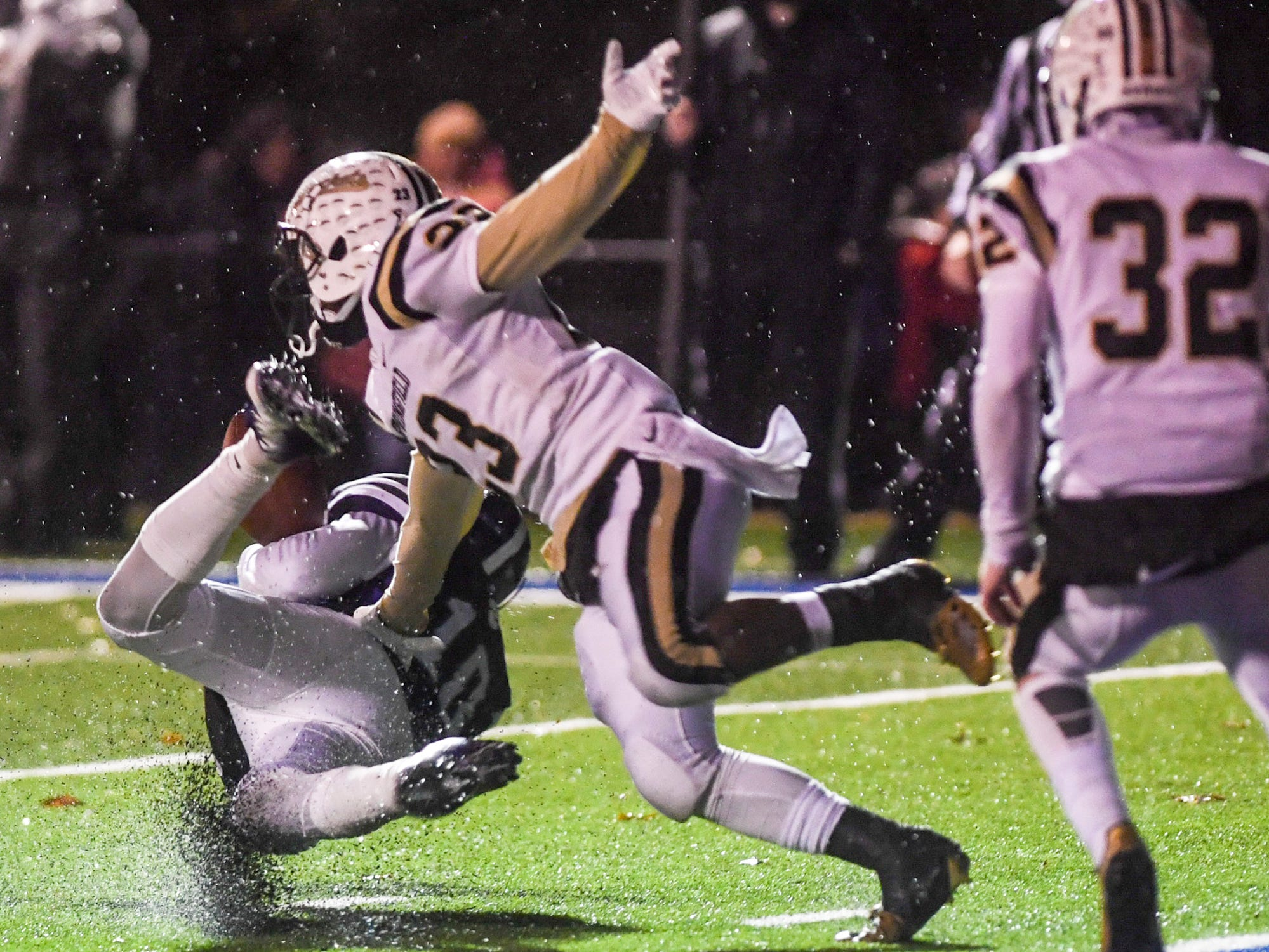"""Haywood's Taylor Shields makes a diving catch at the 2-yard-line while defended by Springfield's Dayron """"Fat Cat"""" Johnson during their Class 4A semifinal game, Friday, November 23. Haywood defeated Springfield, 49-14."""