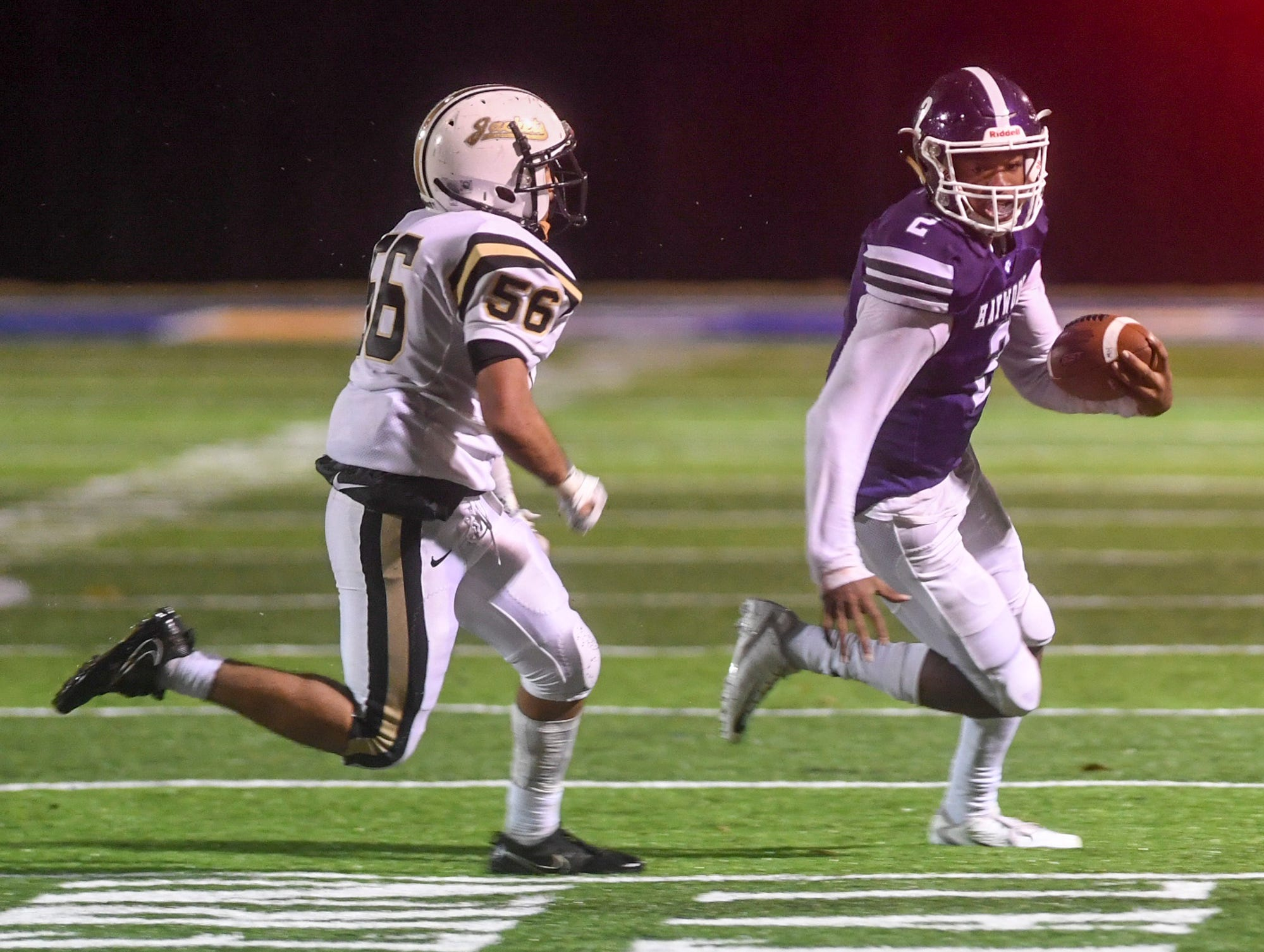 Haywood's Deyondrius Hines runs away from Travarion Kendrick during their Class 4A semifinal game, Friday, November 23. Haywood defeated Springfield, 49-14.