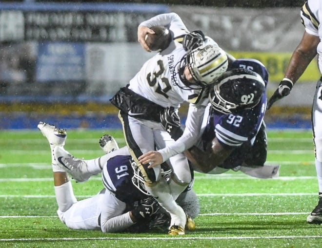 Haywood's Jerwin Young and Haywood's Xavier King tackle Springfield's Bryan Hayes during their Class 4A semifinal game, Friday, November 23. Haywood defeated Springfield, 49-14.