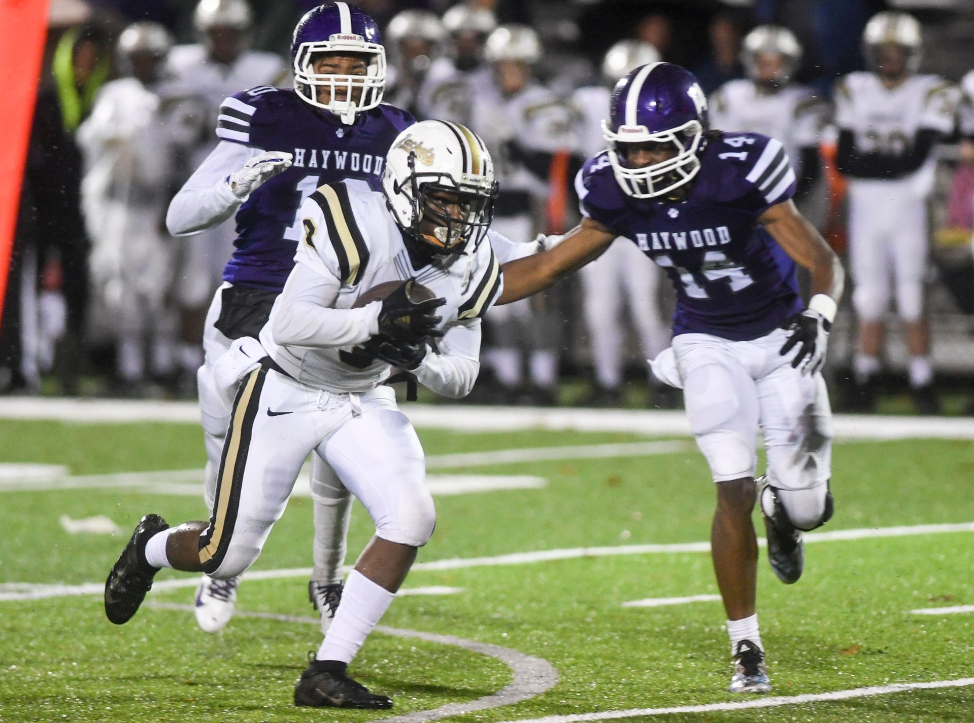 Springfield's Keith Jones is chased down by Haywood's Taylor Shields and Haywood's Calen Johnson during their Class 4A semifinal game, Friday, November 23. Haywood defeated Springfield, 49-14.