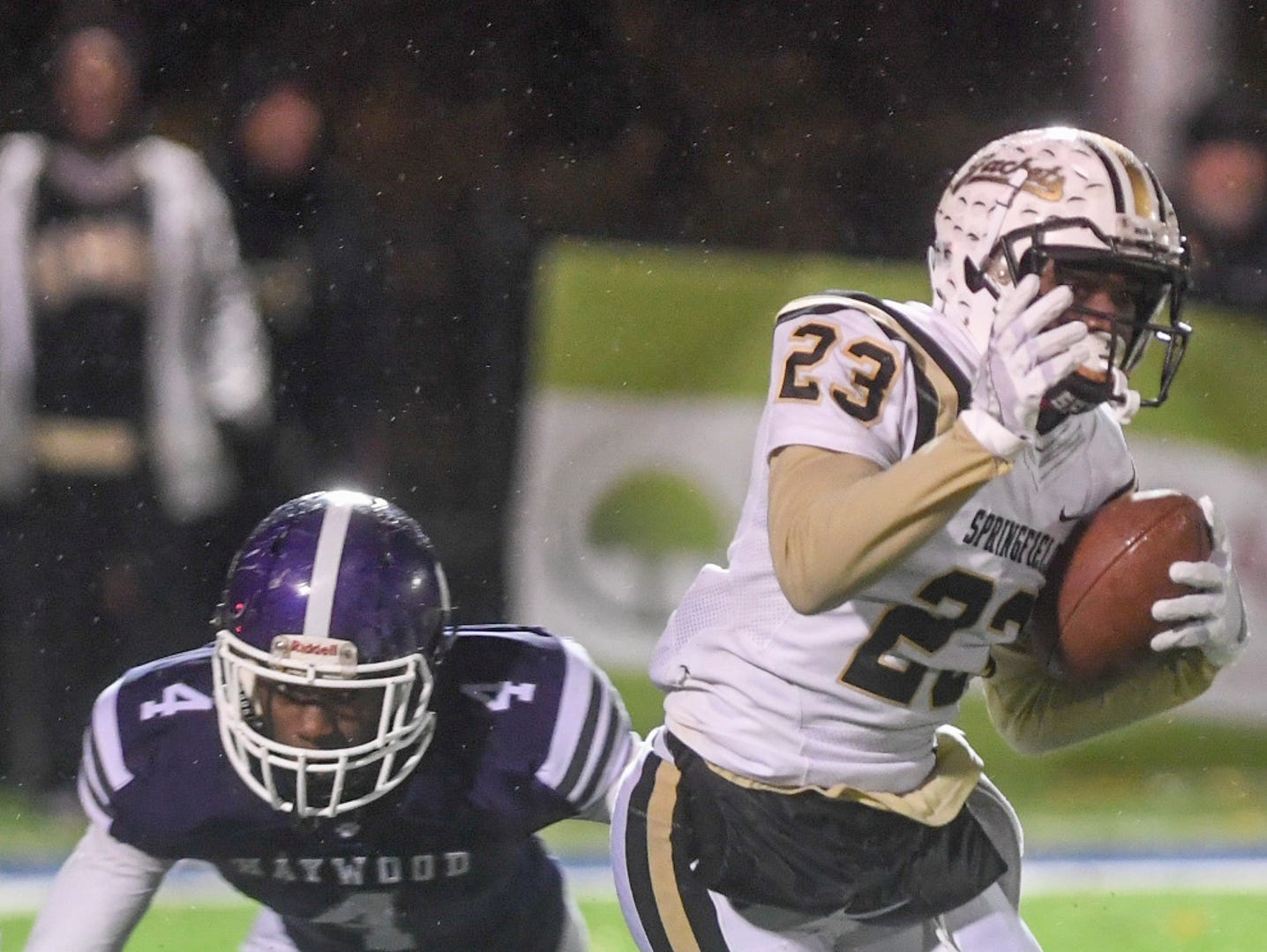 """Springfield's Dayron """"Fat Cat"""" Johnson shakes Haywood's Darion Williamson during their Class 4A semifinal game, Friday, November 23. Haywood defeated Springfield, 49-14."""