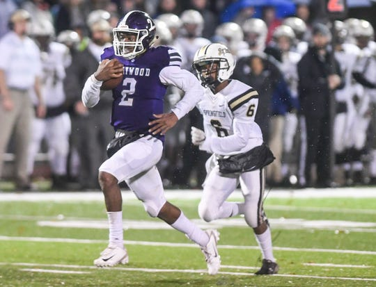 Haywood's Deyondrius Hines runs the ball while being chased by Springfield's Cory Bigsbee during their Class 4A semifinal game, Friday, November 23. Haywood defeated Springfield, 49-14.