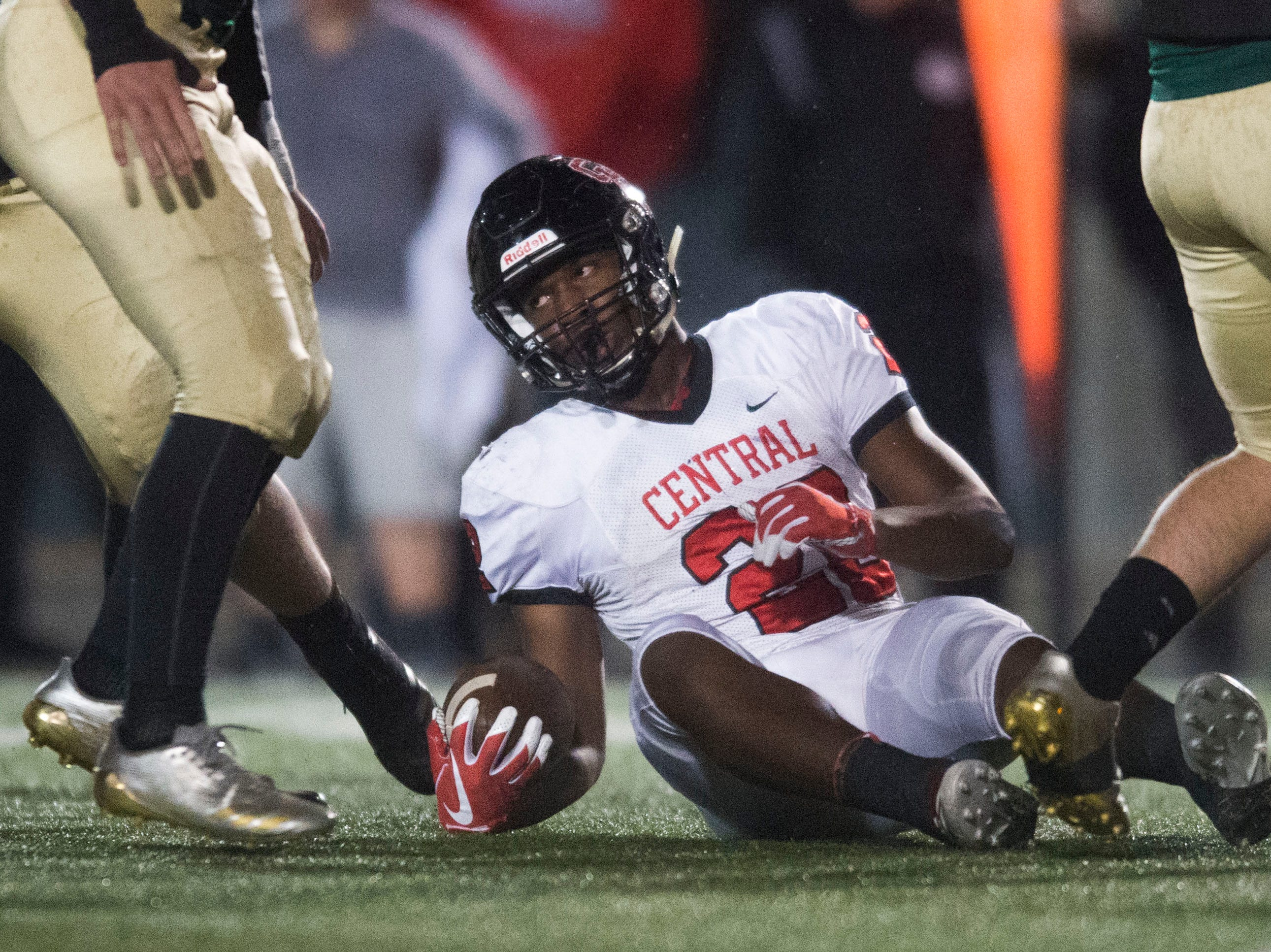 Central's Devone Moss (22) gets off the the ground after a play during a Class 5A semifinal game between Central at Catholic Friday, Nov. 23, 2018. Central defeated Catholic 24-19.