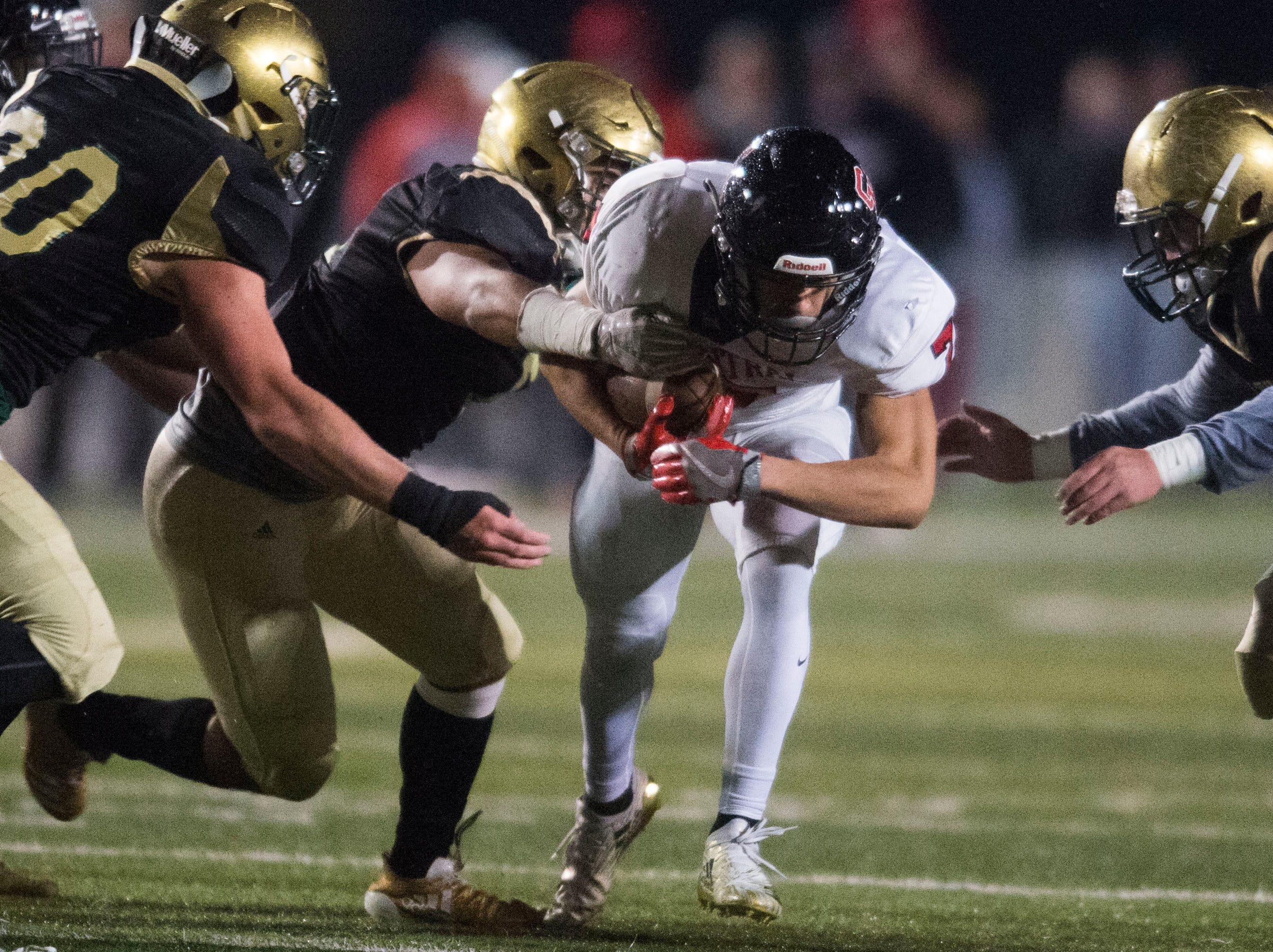 Central's Braden Gaston (7) is taken down during a Class 5A semifinal game between Central at Catholic Friday, Nov. 23, 2018. Central defeated Catholic 24-19.