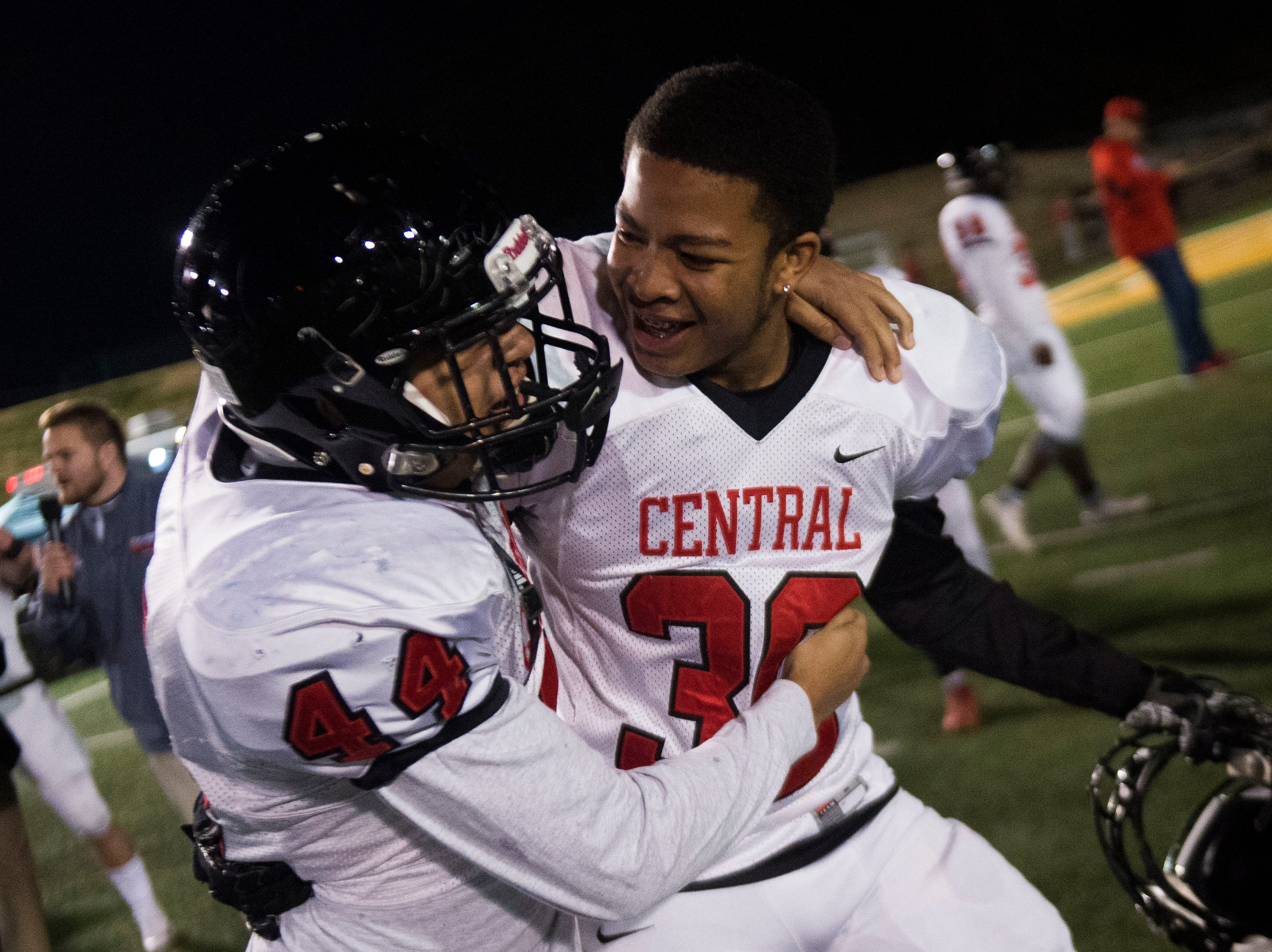 Central players celebrate after a Class 5A semifinal game between Central at Catholic Friday, Nov. 23, 2018. Central defeated Catholic 24-19.