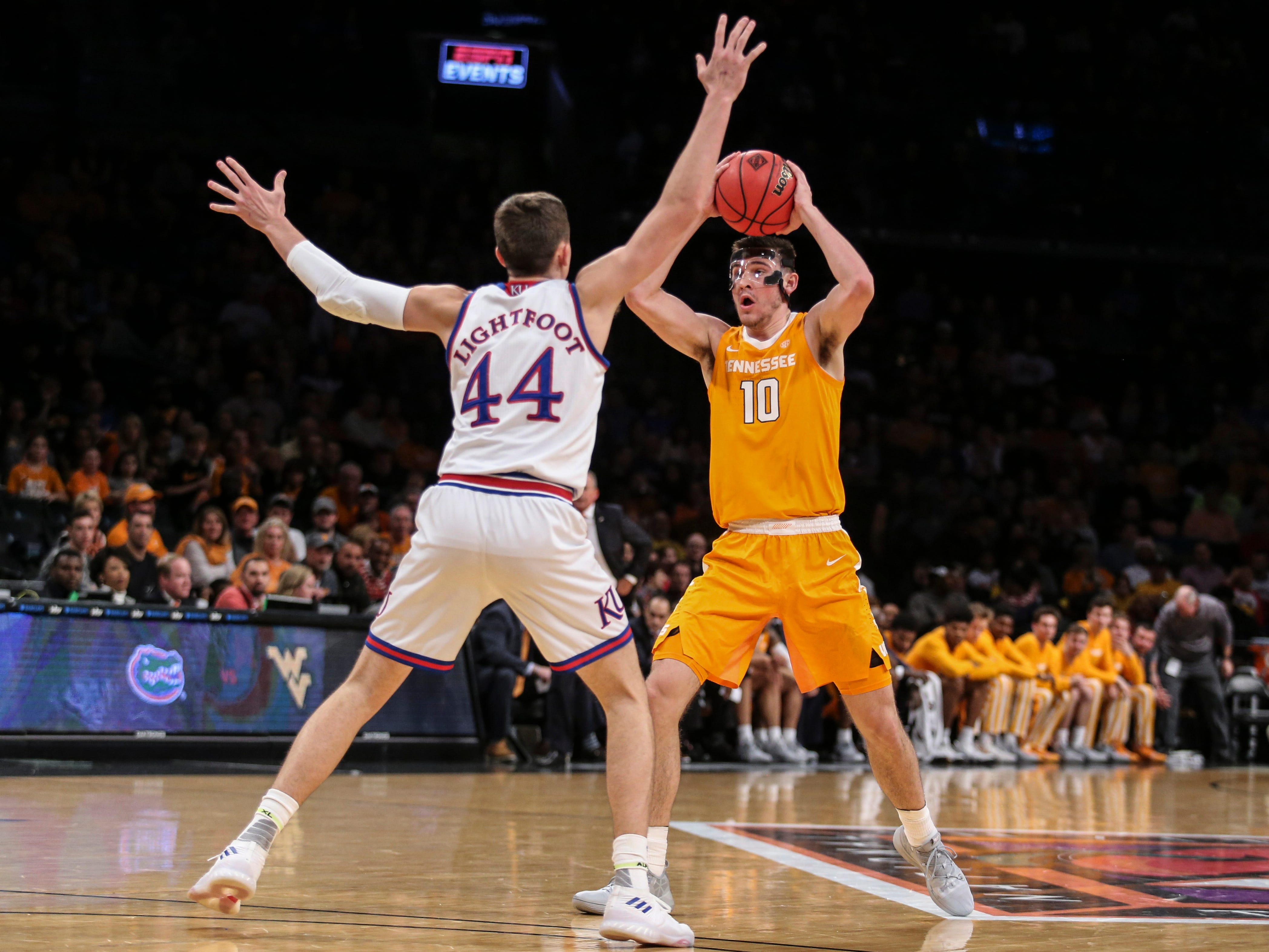 Nov 23, 2018; Brooklyn, NY, USA; Tennessee Volunteers forward John Fulkerson (10) is defended by Kansas Jayhawks forward Mitch Lightfoot (44) in the first half of the championship game of the NIT Season Tipoff at Barclays Center. Mandatory Credit: Wendell Cruz-USA TODAY Sports