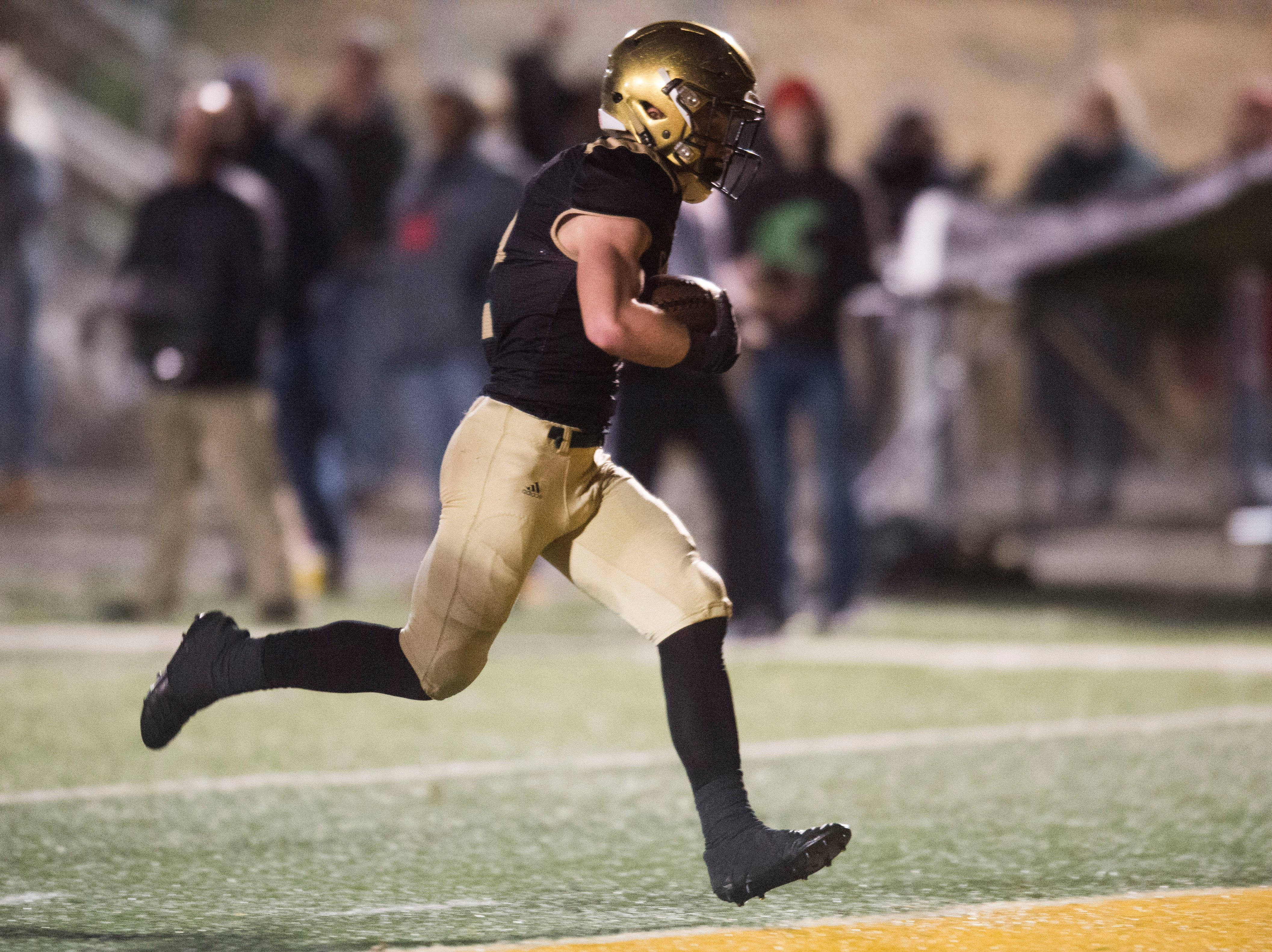 Catholic's Taylor Shannon (2) makes a touch down during a Class 5A semifinal game between Central at Catholic Friday, Nov. 23, 2018. Central defeated Catholic 24-19.