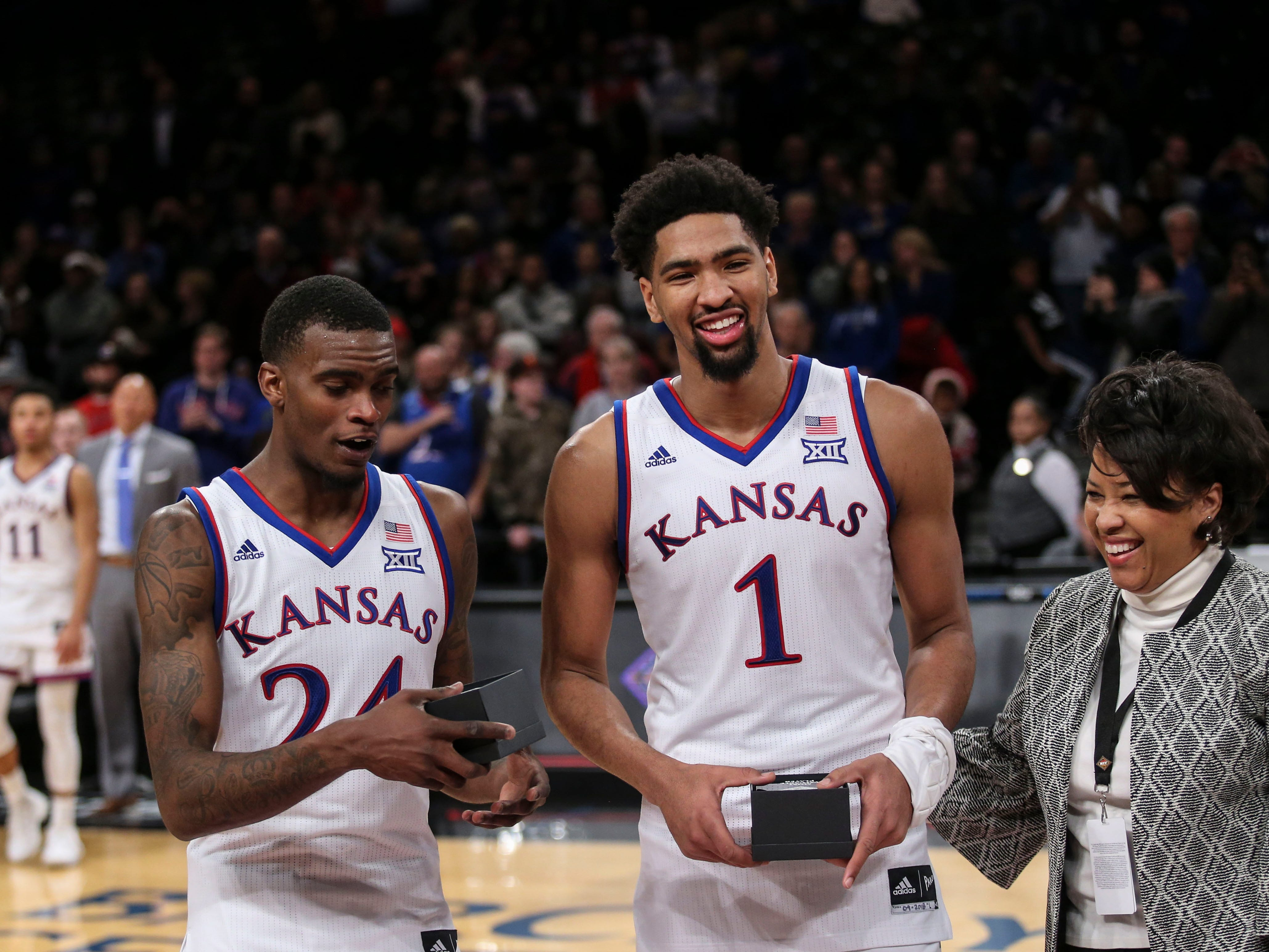 Nov 23, 2018; Brooklyn, NY, USA; Kansas Jayhawks forward Dedric Lawson (1) and guard Lagerald Vick (24) after beating the Tennessee Volunteers in the NIT Season Tipoff Championship at Barclays Center. Mandatory Credit: Wendell Cruz-USA TODAY Sports