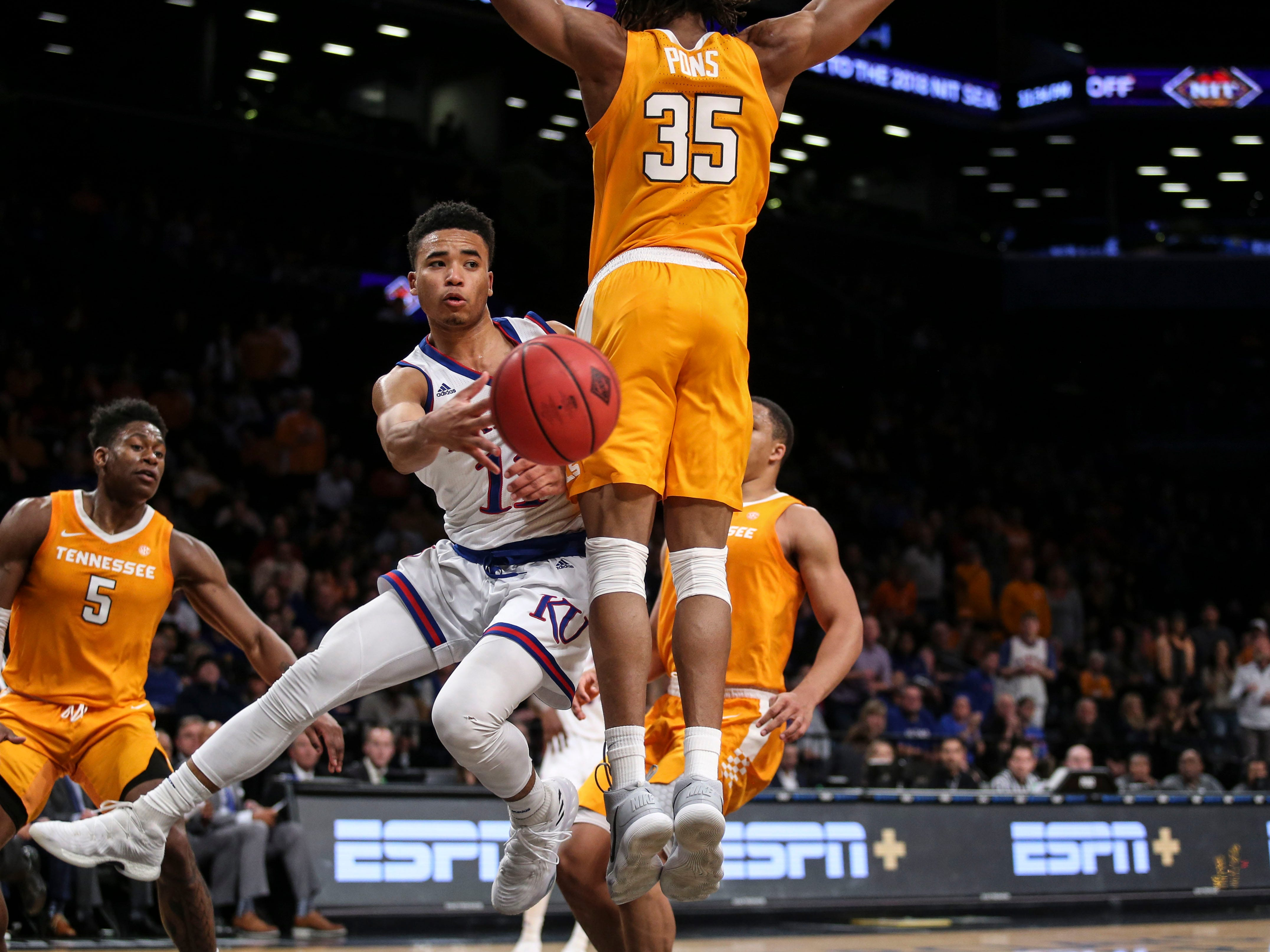 Nov 23, 2018; Brooklyn, NY, USA; Kansas Jayhawks guard Devon Dotson (11) makes a pass against the Tennessee Volunteers in the second half of the NIT Season Tipoff Championship at Barclays Center. Mandatory Credit: Wendell Cruz-USA TODAY Sports