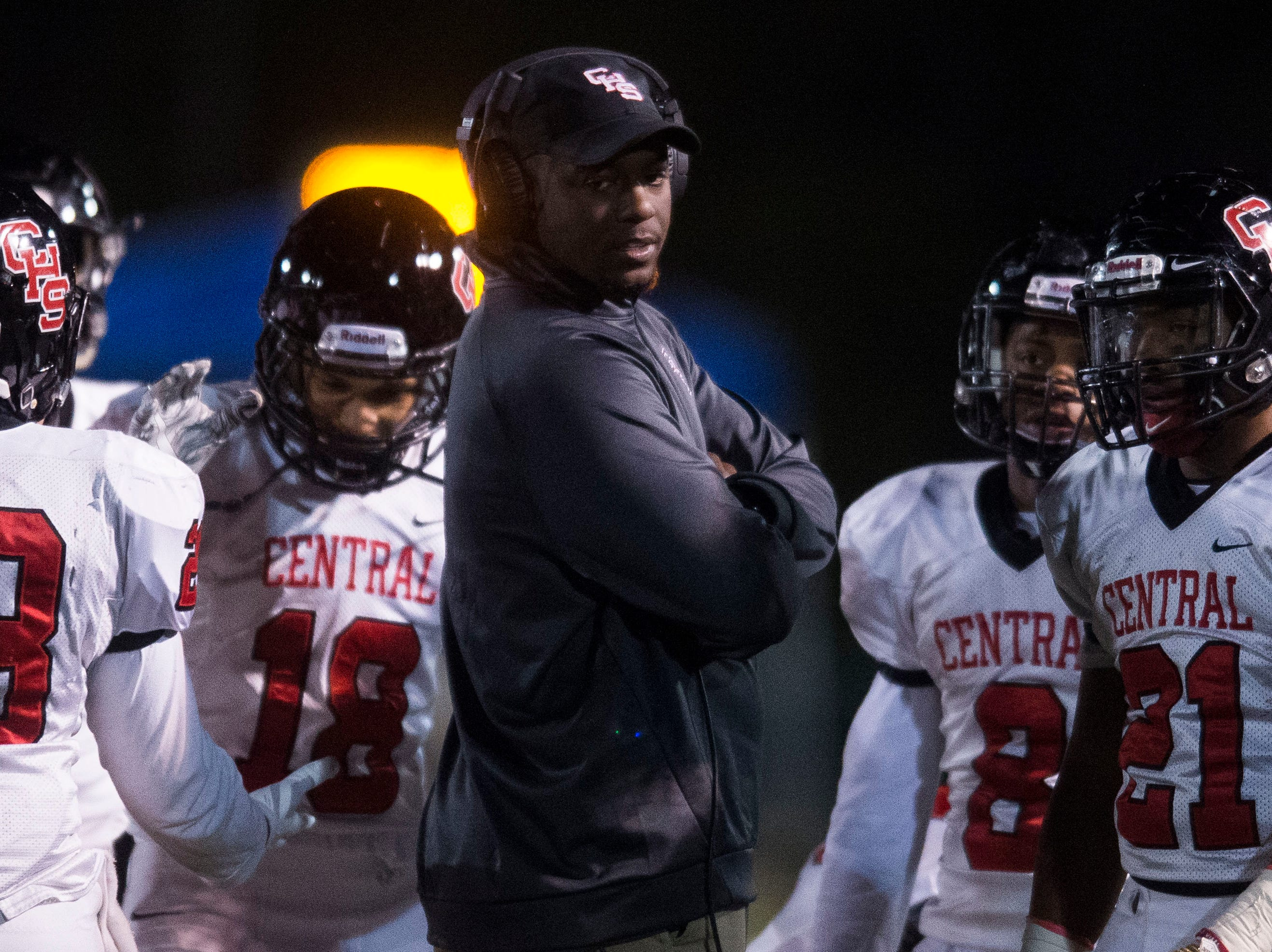 Central head coach Bryson Rosser speaks to his players on the field during a Class 5A semifinal game between Central at Catholic Friday, Nov. 23, 2018. Central defeated Catholic 24-19.