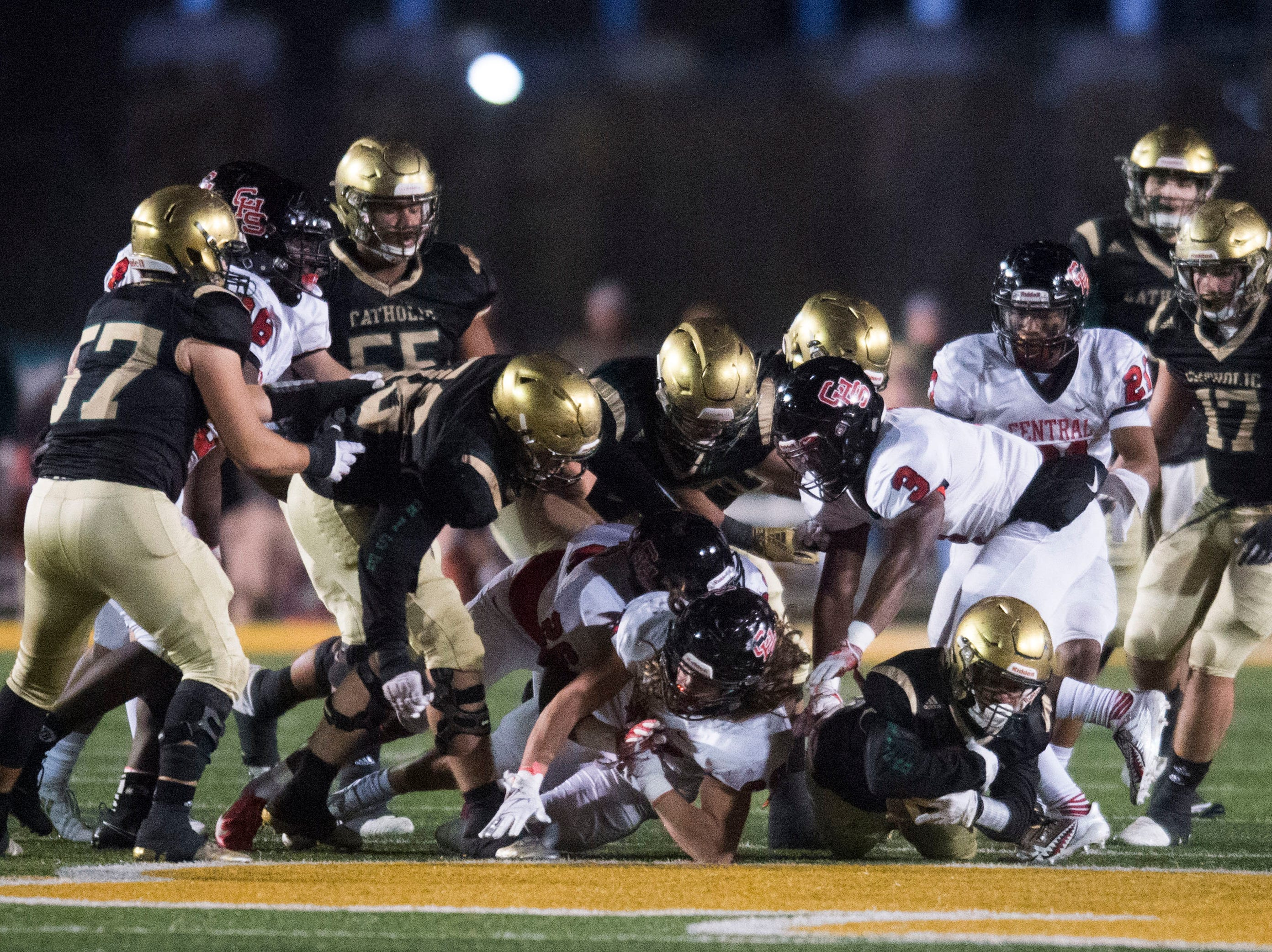 Catholic and Central players collide on the field during a Class 5A semifinal game between Central at Catholic Friday, Nov. 23, 2018. Central defeated Catholic 24-19.