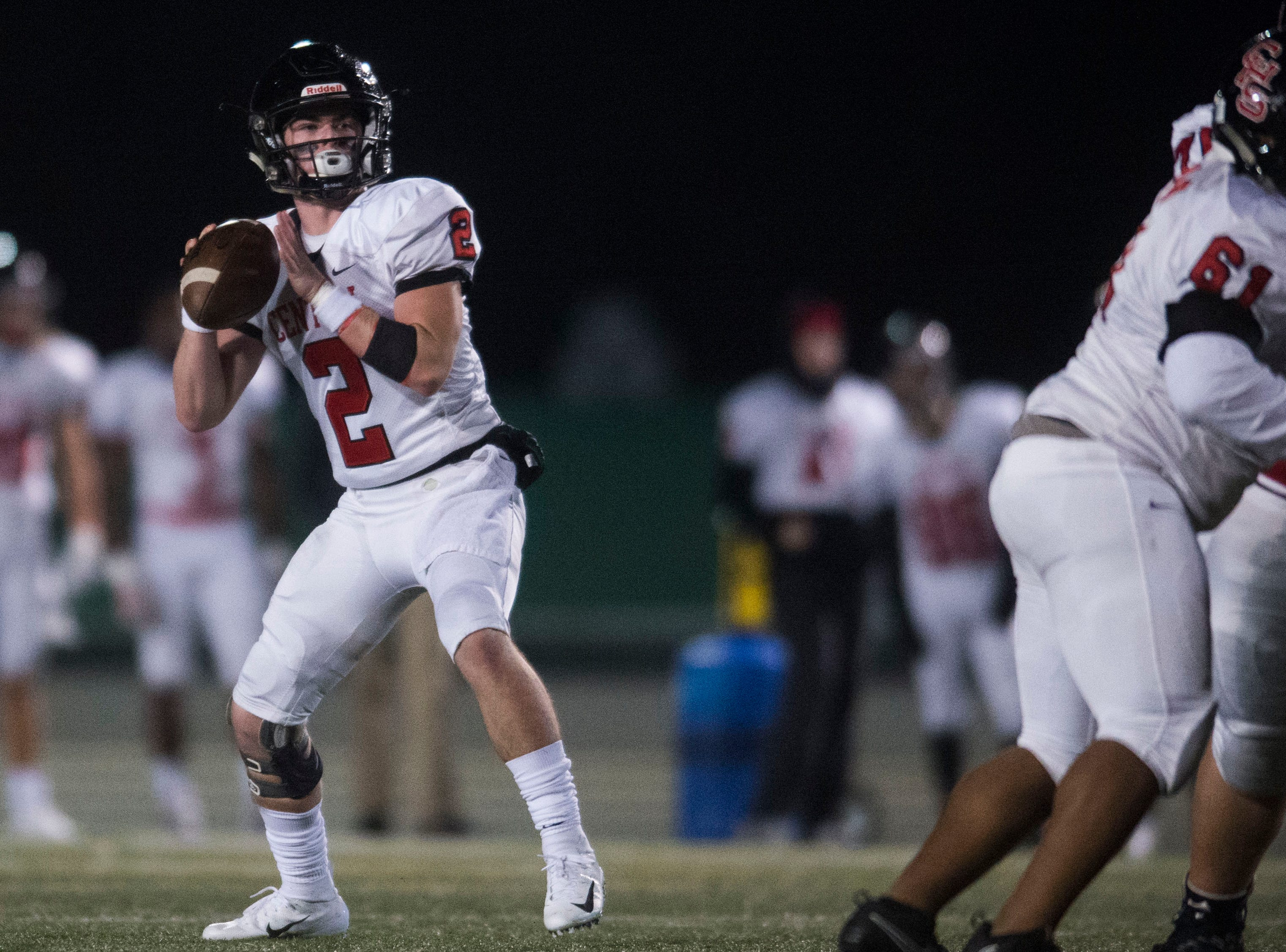 Central's Dakota Fawver (2) prepares to throw the ball during a Class 5A semifinal game between Central at Catholic Friday, Nov. 23, 2018. Central defeated Catholic 24-19.