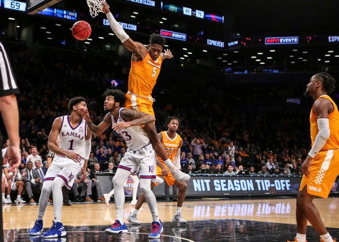 Nov 23, 2018; Brooklyn, NY, USA; Tennessee Volunteers guard Admiral Schofield (5) collides with Kansas Jayhawks  guard K.J. Lawson (13) in the second half of the NIT Season Tipoff Championship at Barclays Center. Mandatory Credit: Wendell Cruz-USA TODAY Sports
