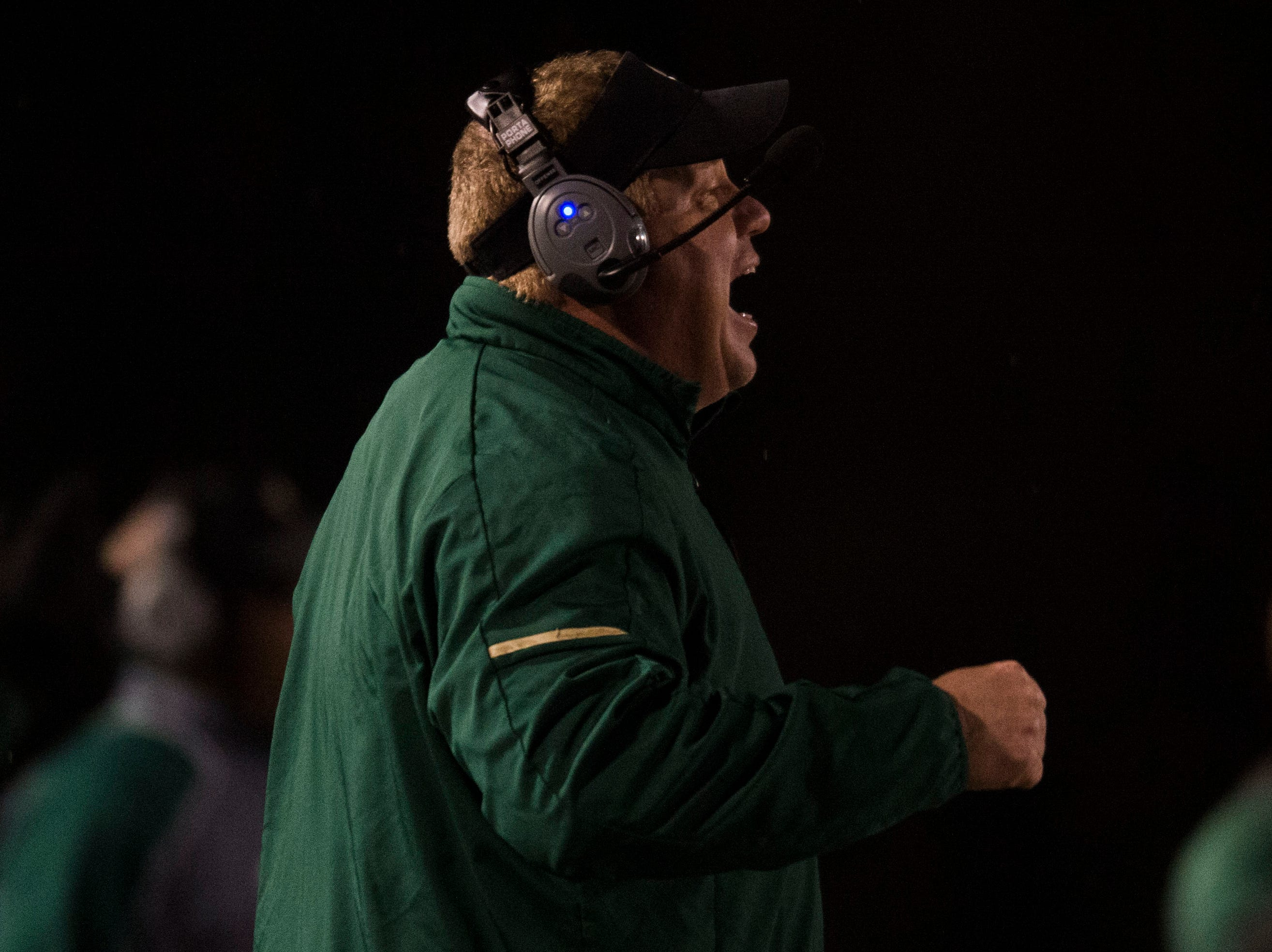 Catholic Head Coach Steve Matthews yells to the field during a Class 5A semifinal game between Central at Catholic Friday, Nov. 23, 2018. Central defeated Catholic 24-19.