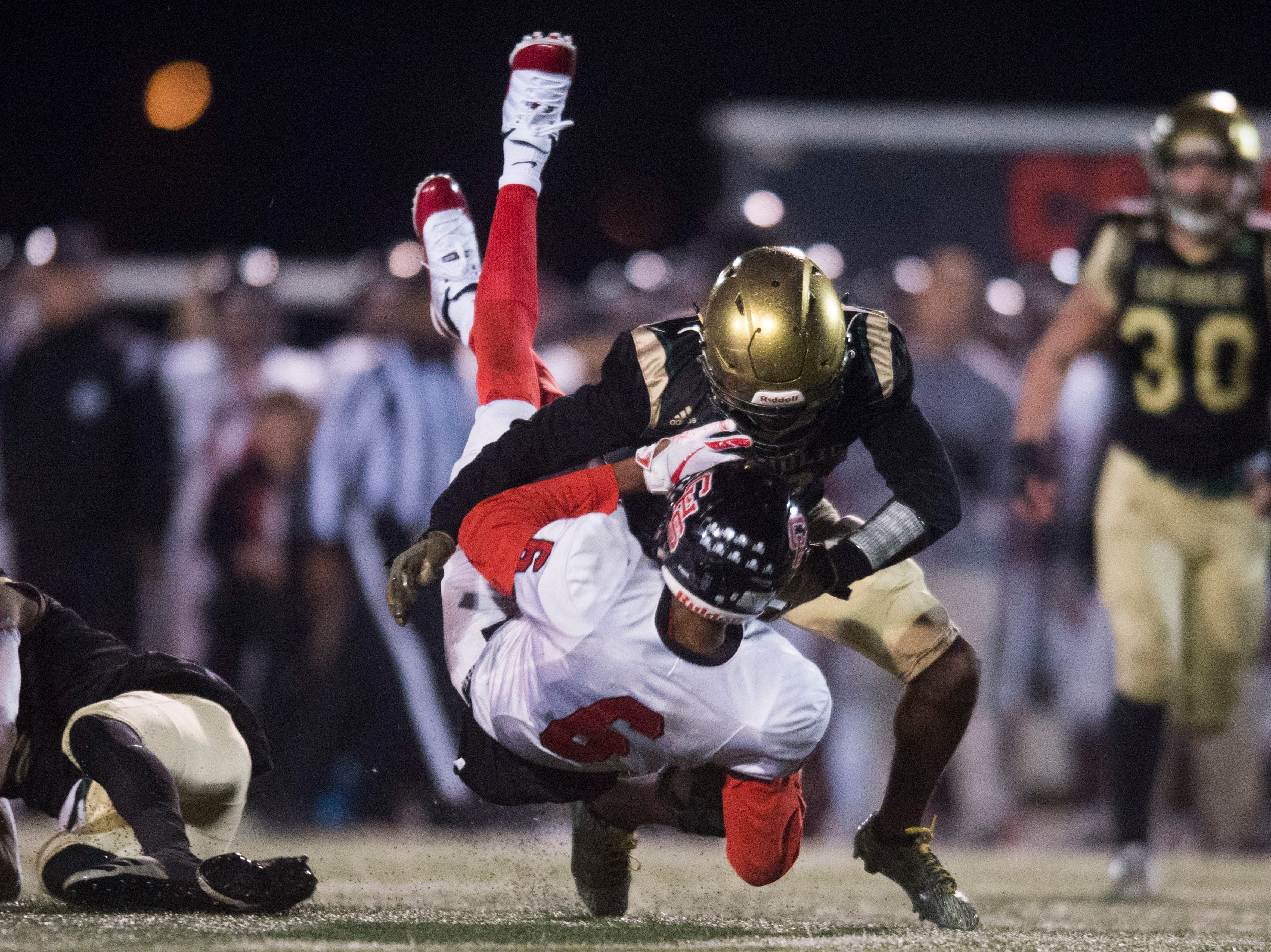 Central's Demetrien Johnson (6) is tackled by Catholic's Ray Thompson (13) during a Class 5A semifinal game between Central at Catholic Friday, Nov. 23, 2018. Central defeated Catholic 24-19.