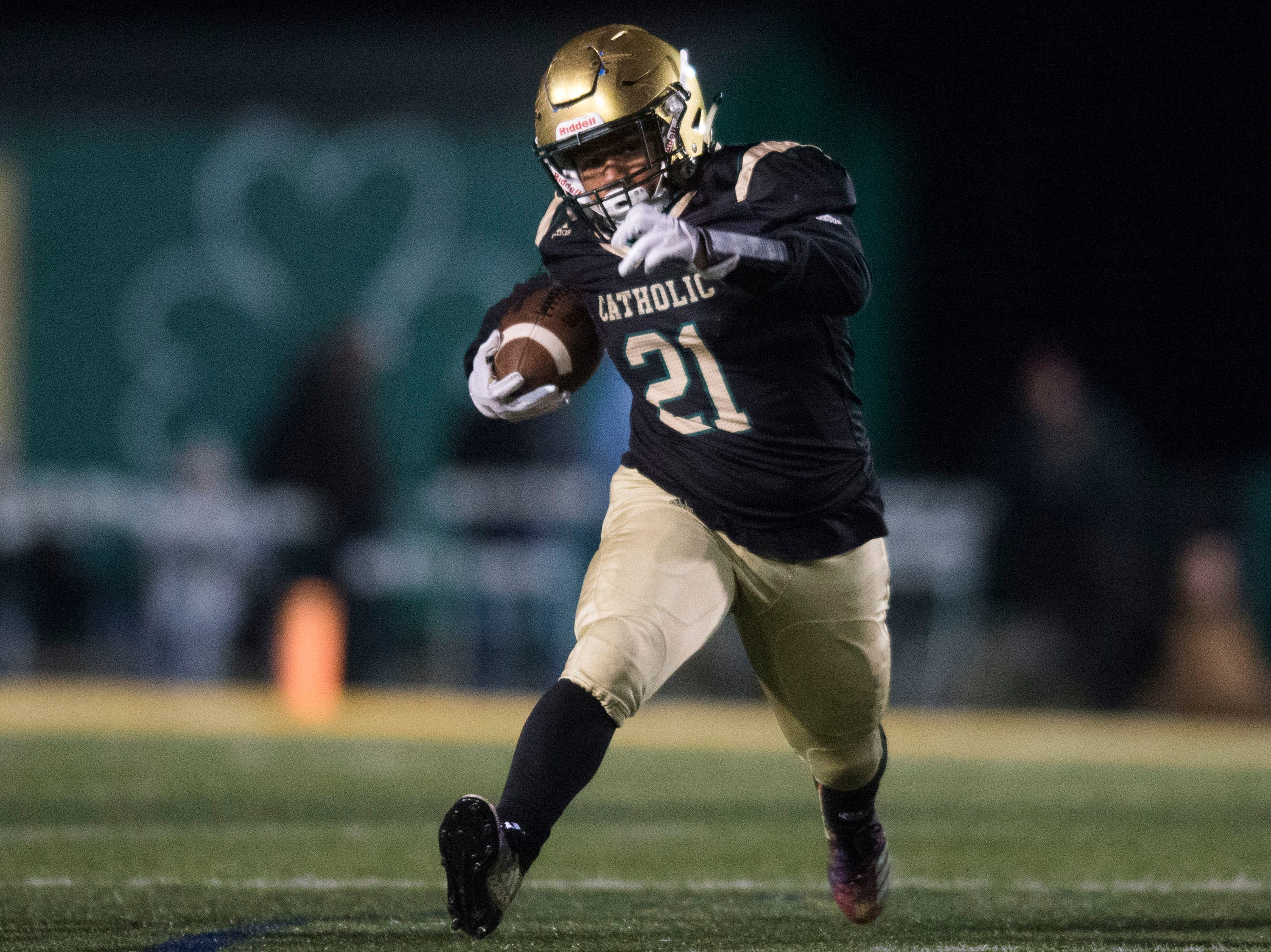 Catholic's Drew Hicks (21) runs the ball during a Class 5A semifinal game between Central at Catholic Friday, Nov. 23, 2018. Central defeated Catholic 24-19.