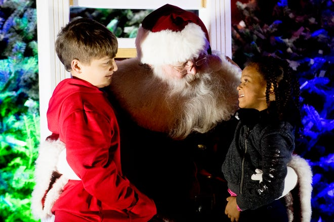 Zane Patt, left, and Zoe Wilfteich, of Dandridge, speak with Santa Claus at the annual Regal Celebration of Lights in downtown Knoxville on Nov. 23. The Central Business Improvement District has been working on a new brand strategy for downtown.