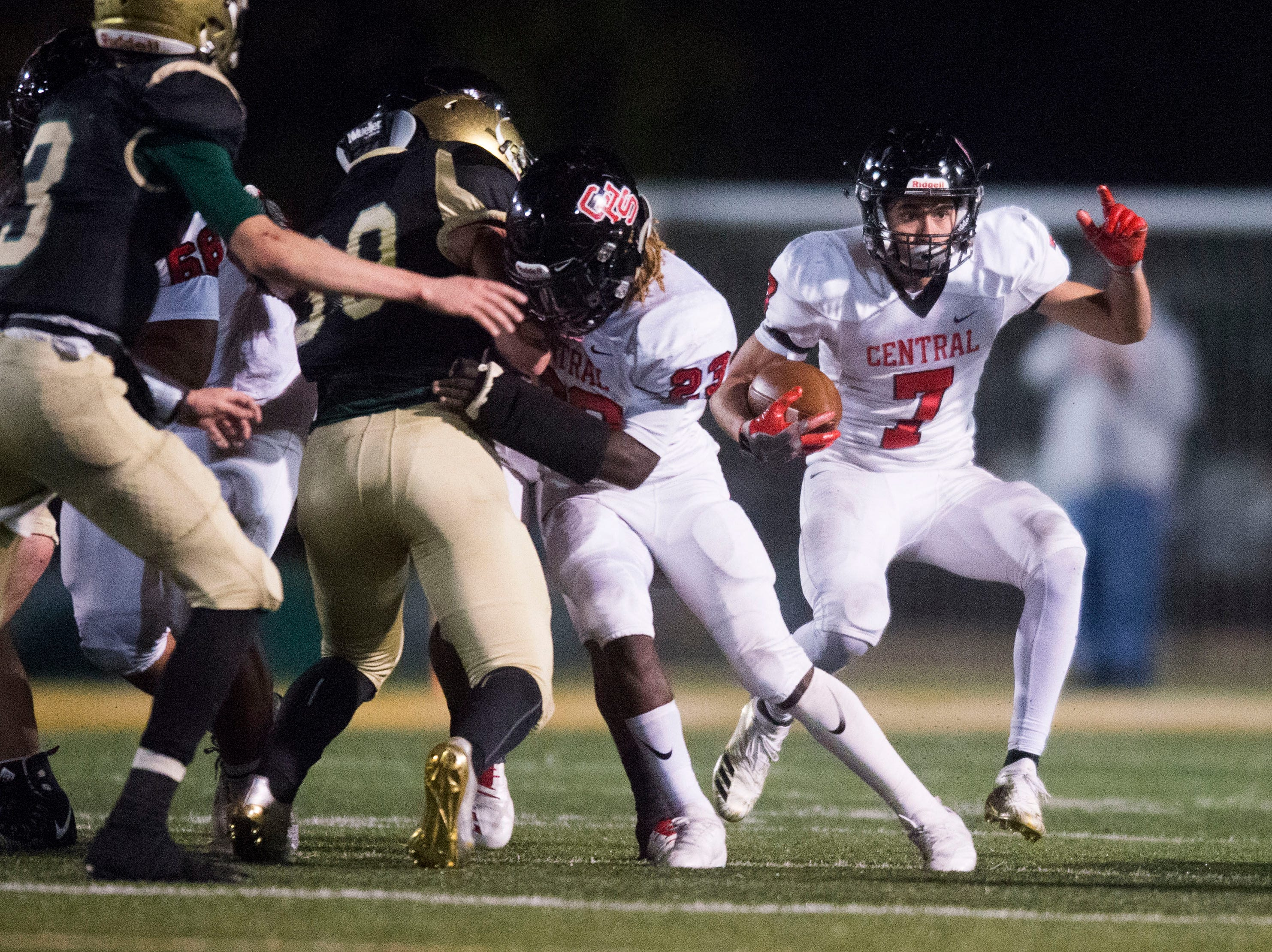 Central's Braden Gaston (7) runs the ball during a Class 5A semifinal game between Central at Catholic Friday, Nov. 23, 2018. Central defeated Catholic 24-19.