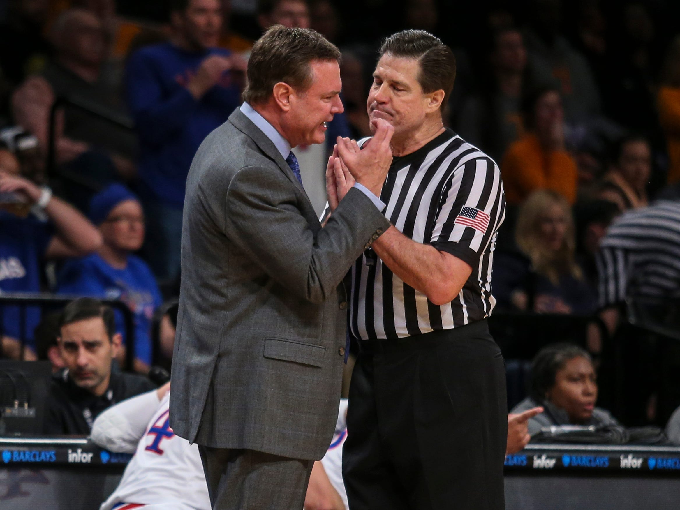Nov 23, 2018; Brooklyn, NY, USA; Kansas Jayhawks head coach disagrees with a call in the first half of the championship game of the NIT Season Tipoff against the Tennessee Volunteers at Barclays Center. Mandatory Credit: Wendell Cruz-USA TODAY Sports