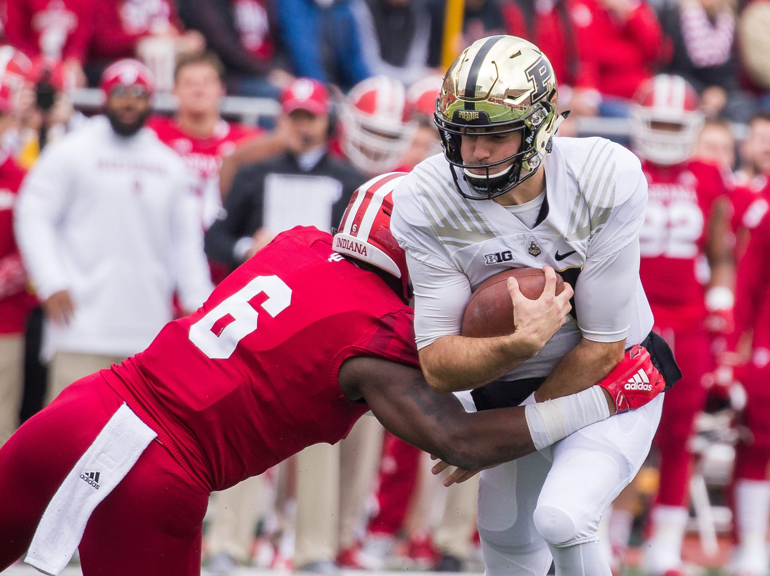 Nov 24, 2018; Bloomington, IN, USA; Purdue Boilermakers quarterback David Blough (11) is tackled by Indiana Hoosiers defensive lineman James Head Jr. (6) in the first quarter at Memorial Stadium. Mandatory Credit: Trevor Ruszkowski-USA TODAY Sports