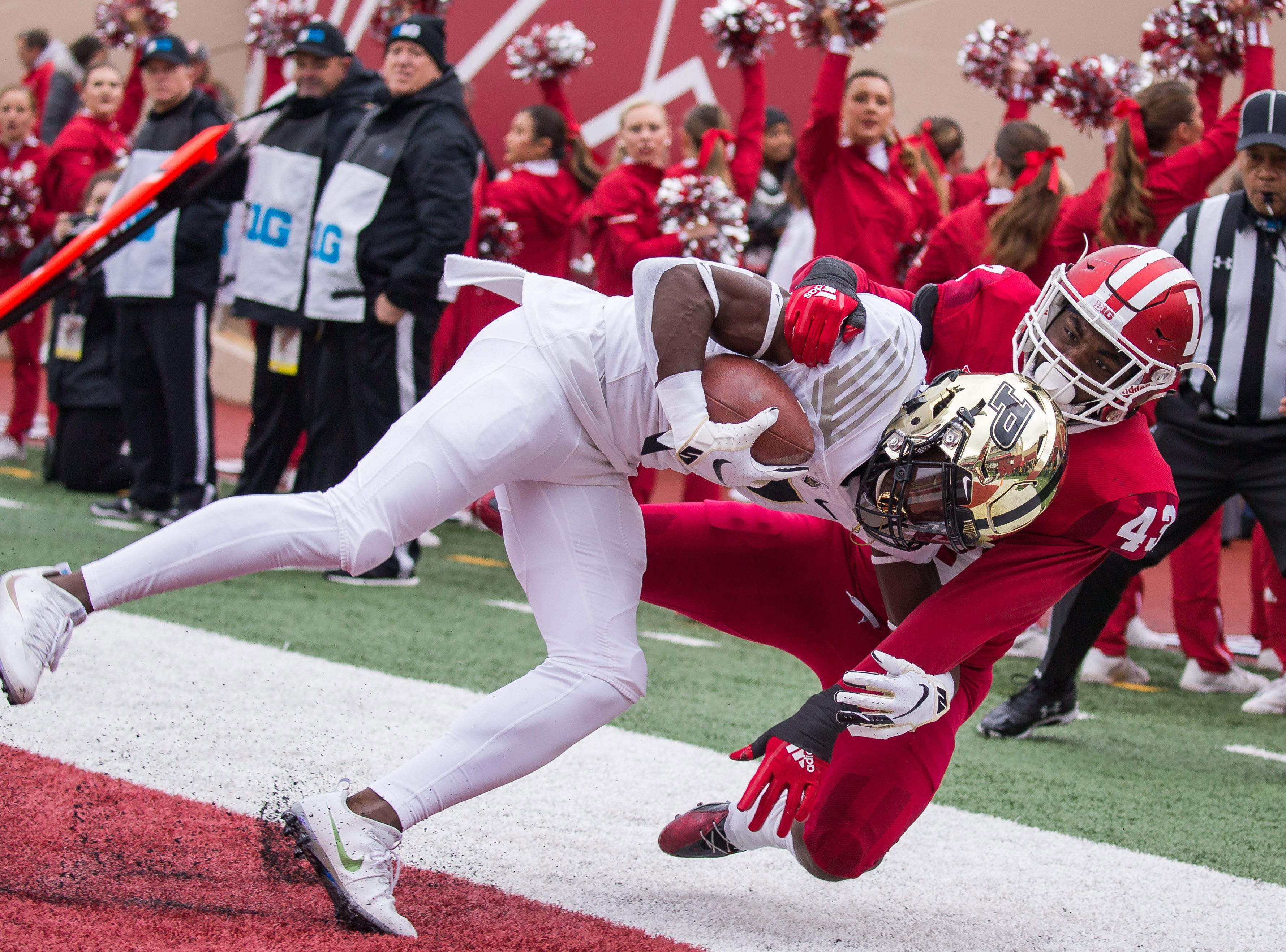 Nov 24, 2018; Bloomington, IN, USA; Purdue Boilermakers wide receiver Isaac Zico (7) catches a touchdown against Indiana Hoosiers linebacker Dameon Willis Jr. (43) in the first quarter at Memorial Stadium. Mandatory Credit: Trevor Ruszkowski-USA TODAY Sports