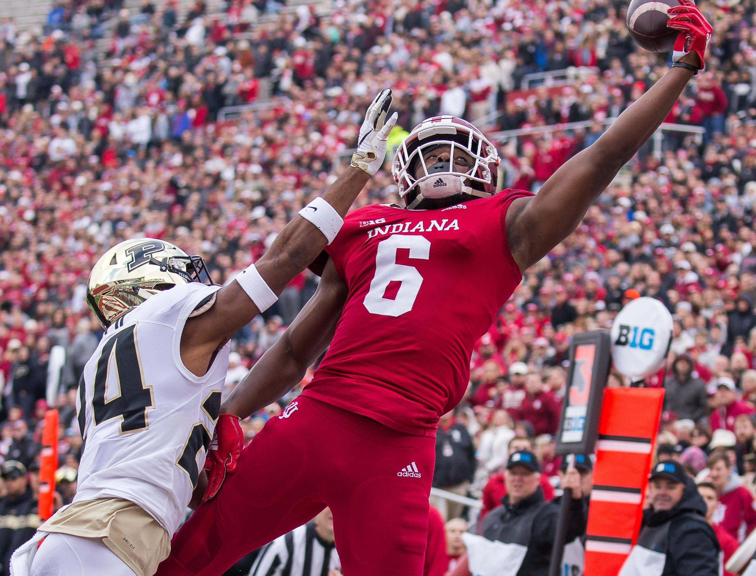 Nov 24, 2018; Bloomington, IN, USA; Indiana Hoosiers wide receiver Donavan Hale (6) attempts to catch a pass against Purdue Boilermakers cornerback Tim Cason (24) in the second quarter at Memorial Stadium. Mandatory Credit: Trevor Ruszkowski-USA TODAY Sports