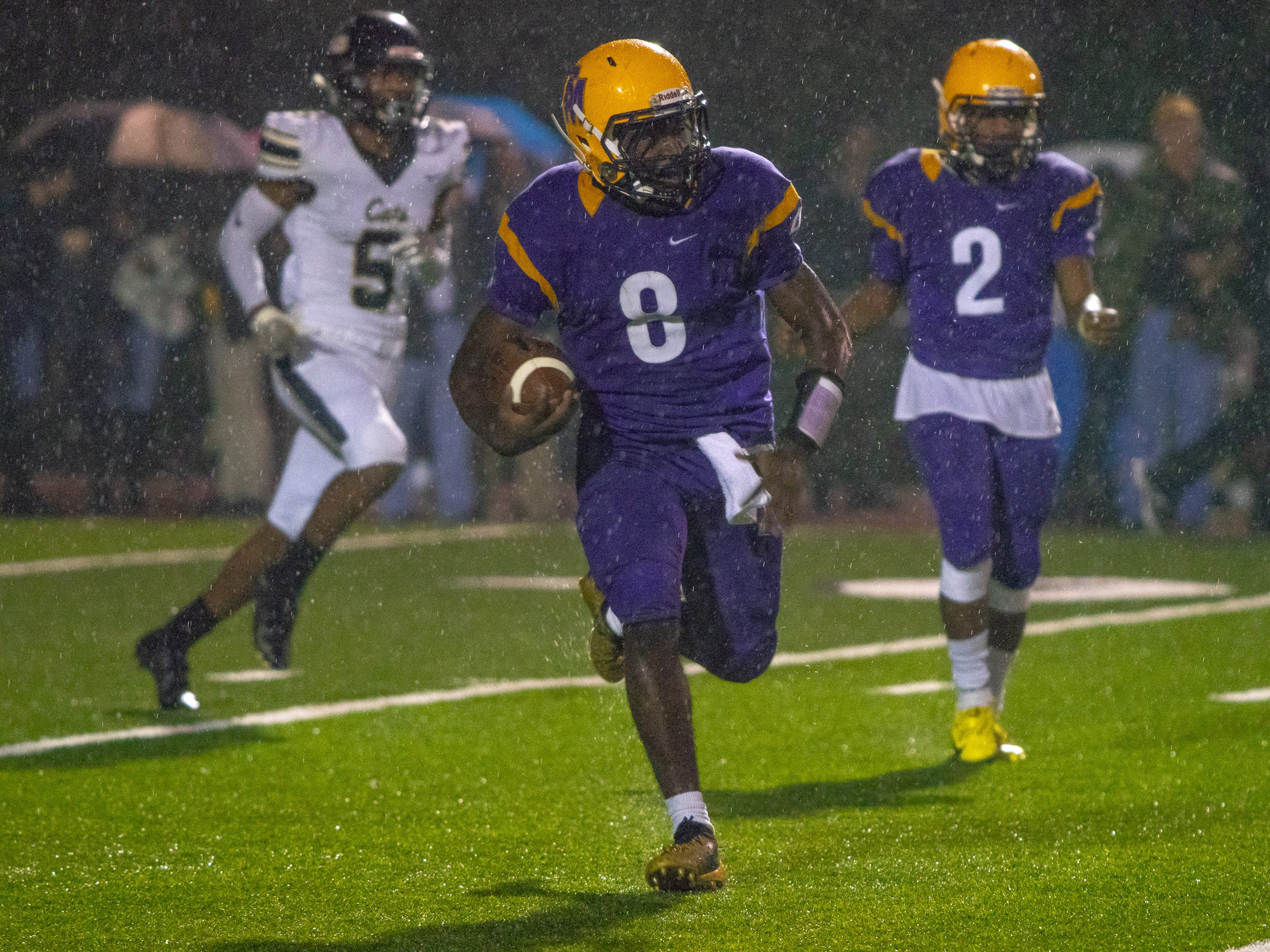 St. Martinville's Markavon Williams sprints with the ball as the St. Martinville Tigers take on the Leesville Wampus Cats at St. Martinville High School on Nov. 23, 2018.