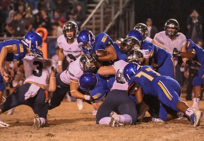 St. Thomas More's defense made life difficult for St. Charles' offense throughout the Cougars' 49-7 Division II road semifinals victory Friday night in LaPlace.