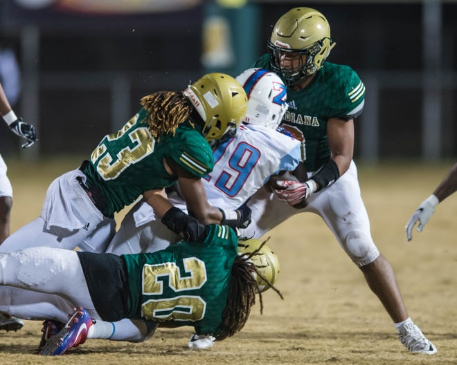 A group of Acadiana High defenders bring down Zachary receiver Chandler Whitfield during the Rams' 26-14 loss to the Broncos in the Class 5A quarterfinals Friday on Ted Davidson Field at Bill Dotson Stadium.