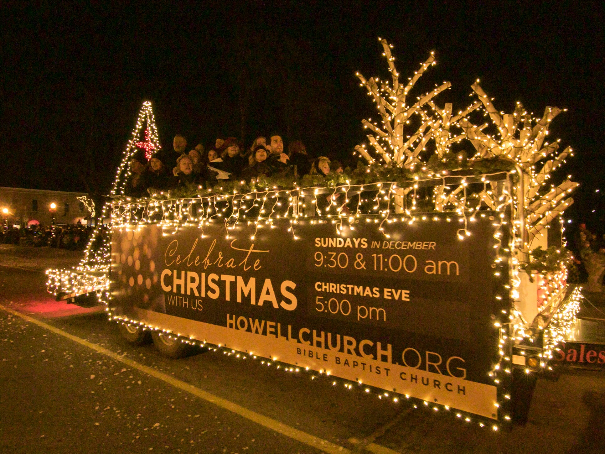 Carolers sing on a float from Howell Bible Baptist Church in the Fantasy of Lights parade Friday, Nov. 23, 2018.
