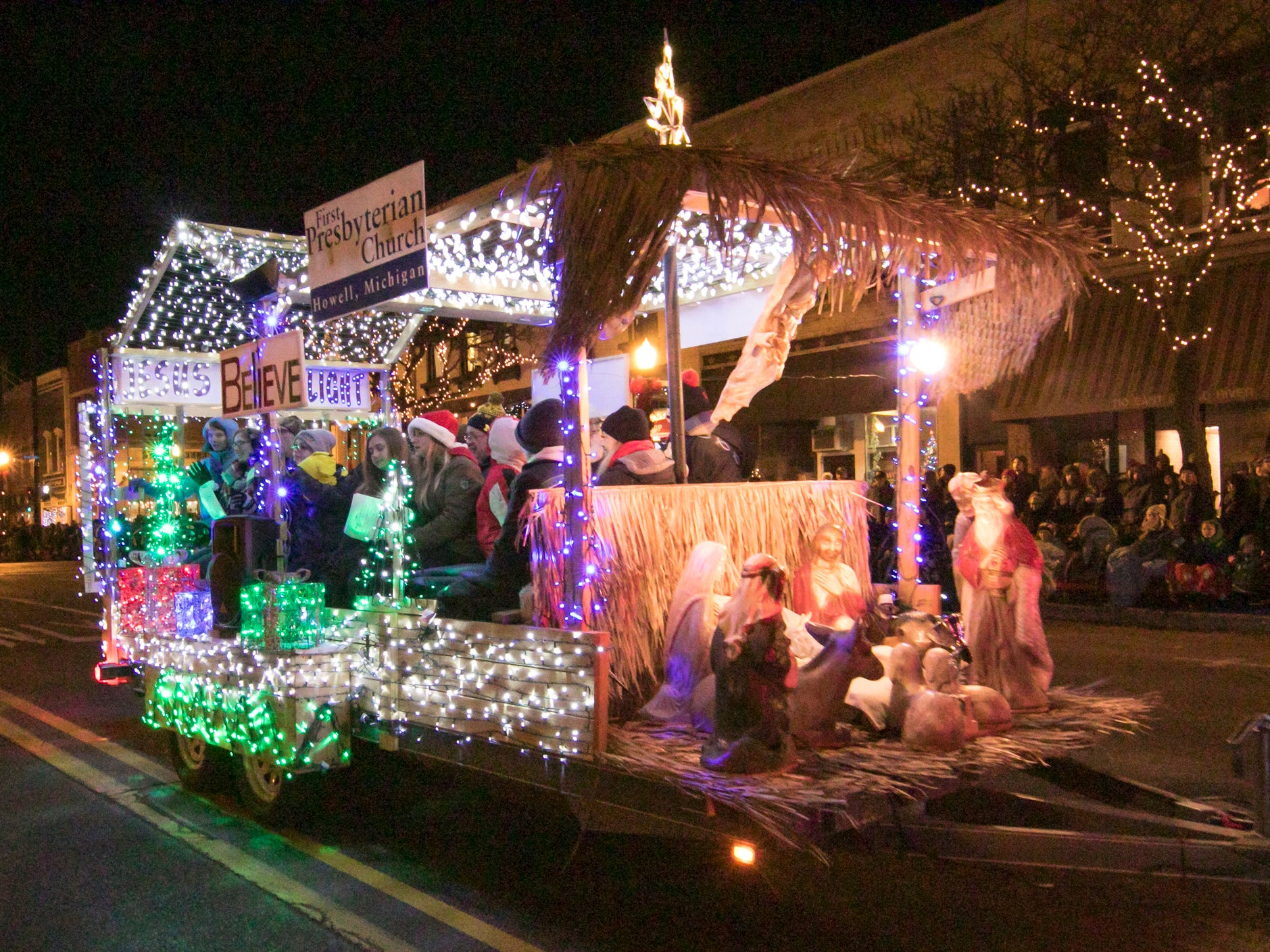 First Presbyterian Church's entry in the Fantasy of Lights parade rides down the parade route Friday, Nov. 23, 2018.