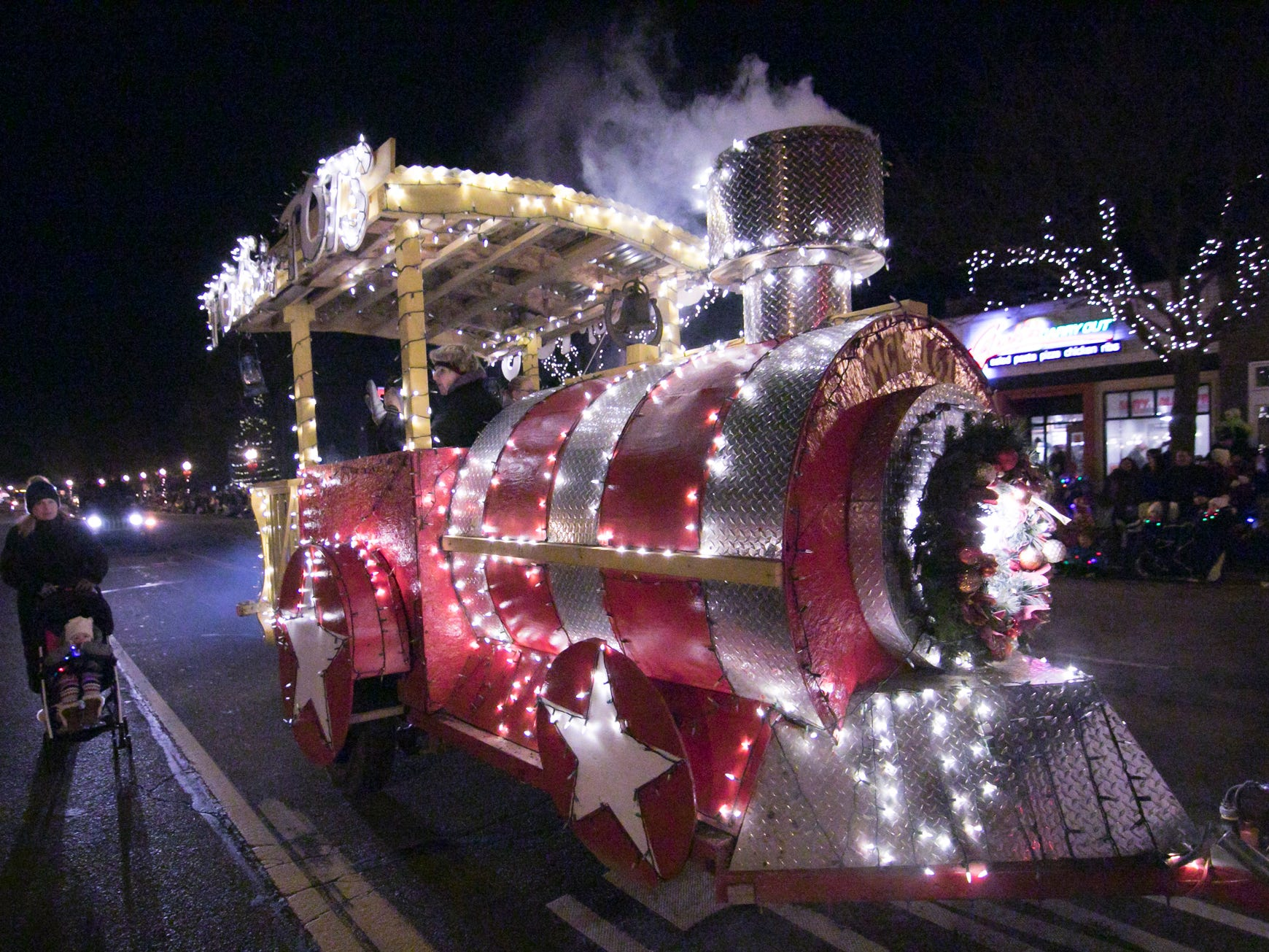 The Toys For Tots entry is the first float in the Fantasy of Lights parade Friday, Nov. 23, 2018.