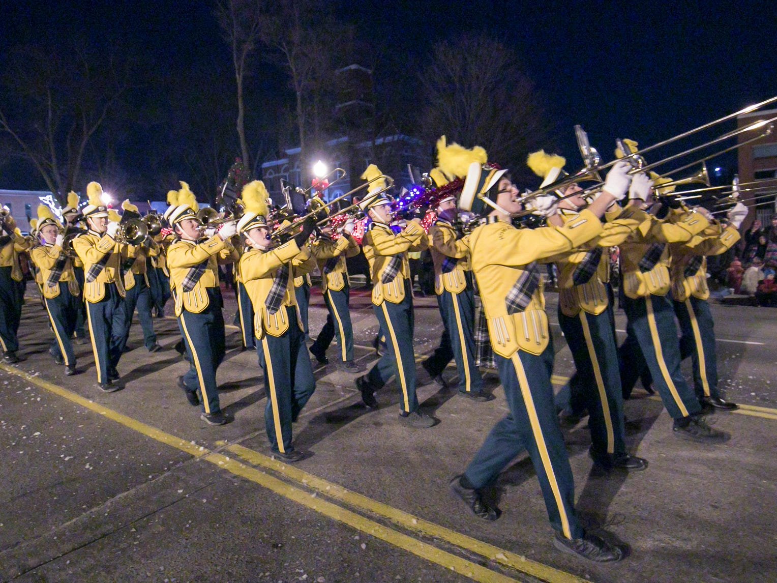 The Howell High School marching band performs in the Fantasy of Lights parade Friday, Nov. 23, 2018.