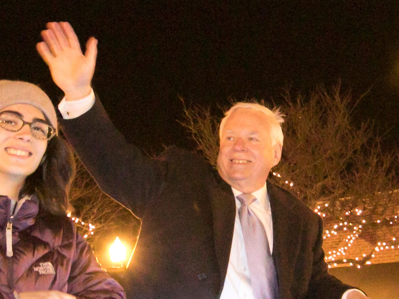 Howell Mayor Nick Proctor waves to the crowd in the Fantasy of Lights parade Friday, Nov. 23, 2018.
