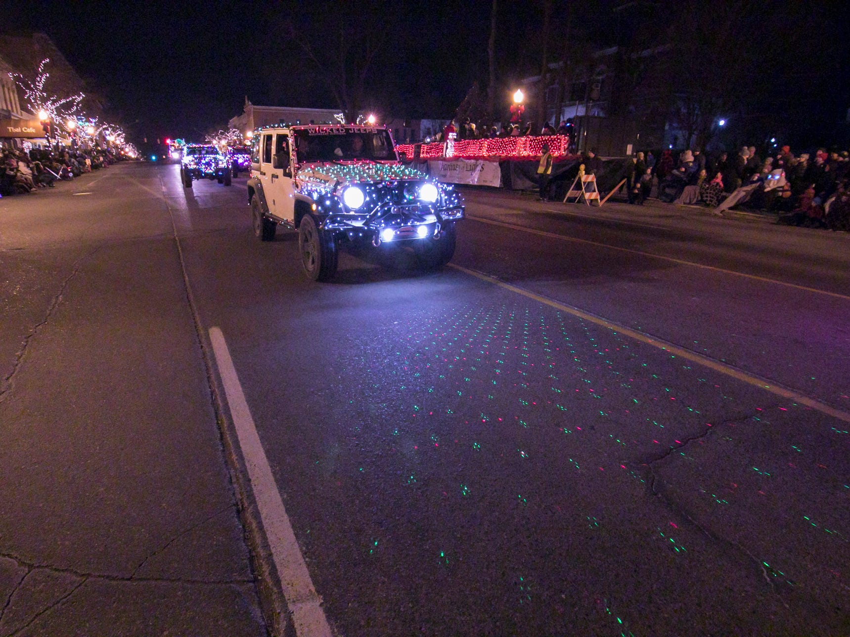 A procession of cars lit with a variety of Christmas lights won the Most Unique award in the Fantasy of Lights parade Friday, Nov. 23, 2018.