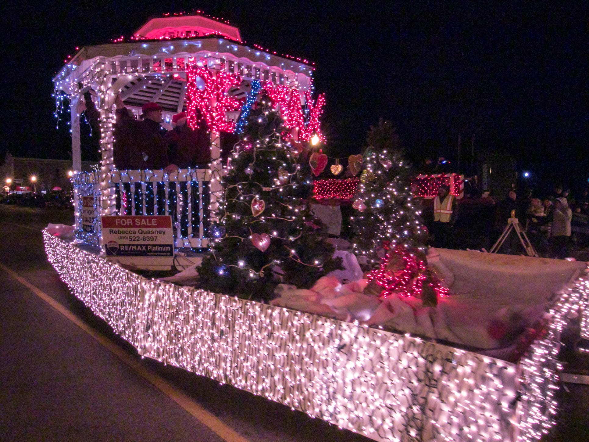 The Re/Max Platinum float makes its annual appearance in the Fantasy of Lights parade Friday, Nov. 23, 2018.