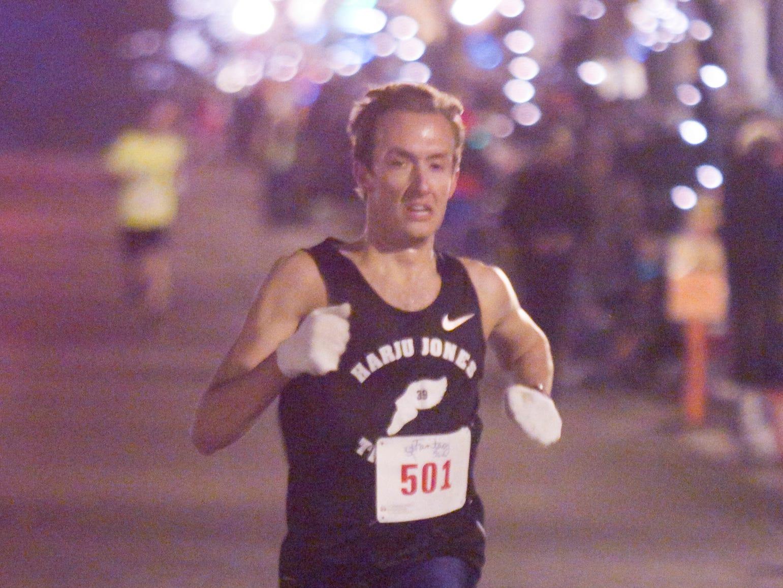 Patrick Miller finishes first in the Fantasy 5k run Friday, Nov. 23, 2018.