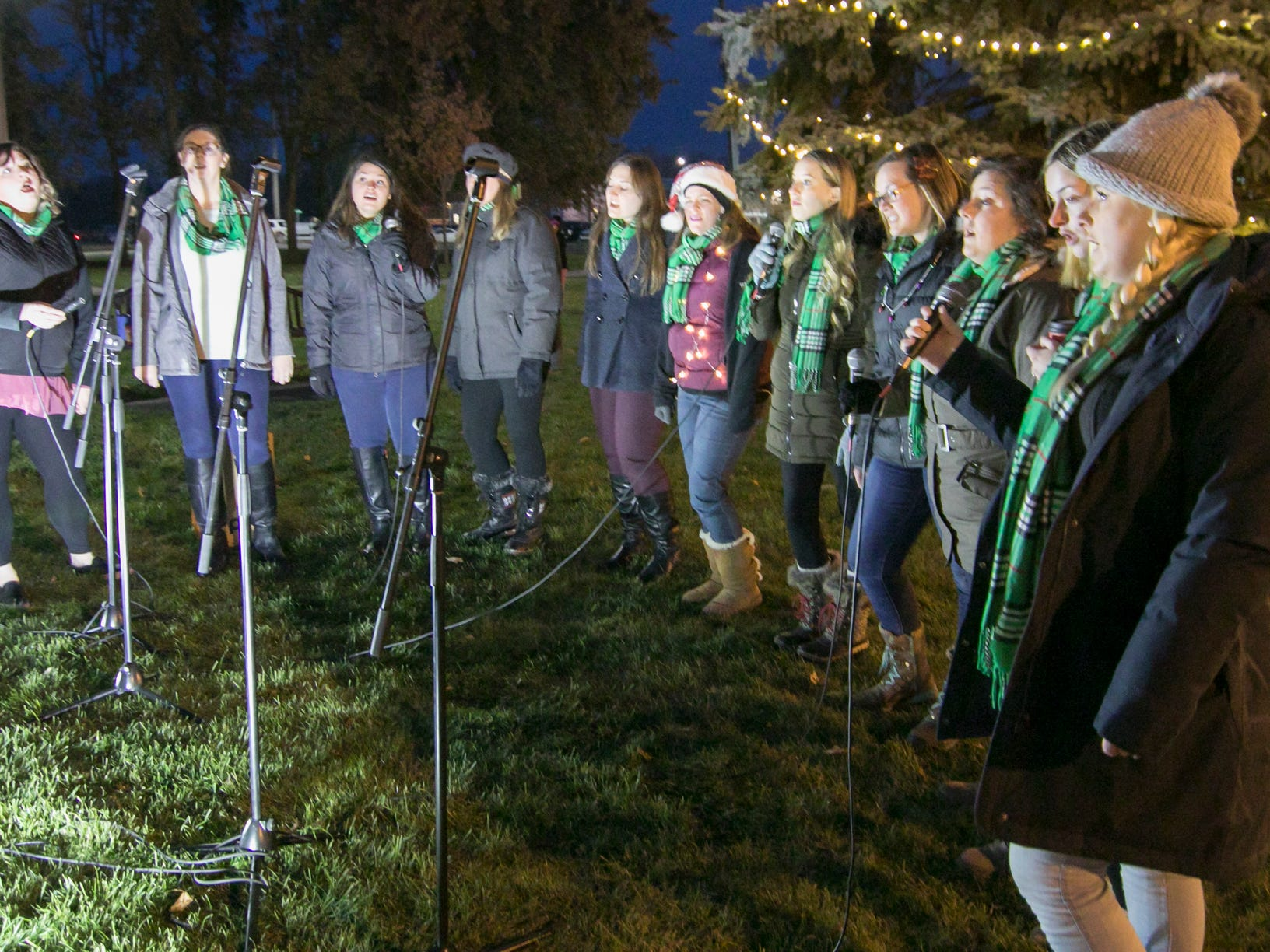 """The Decibelles, an a cappella singing subset of the Livingston County Choirs, sings """"What Child is This?"""" Friday, Nov. 23, 2018 before the start of the Fantasy of Lights parade."""