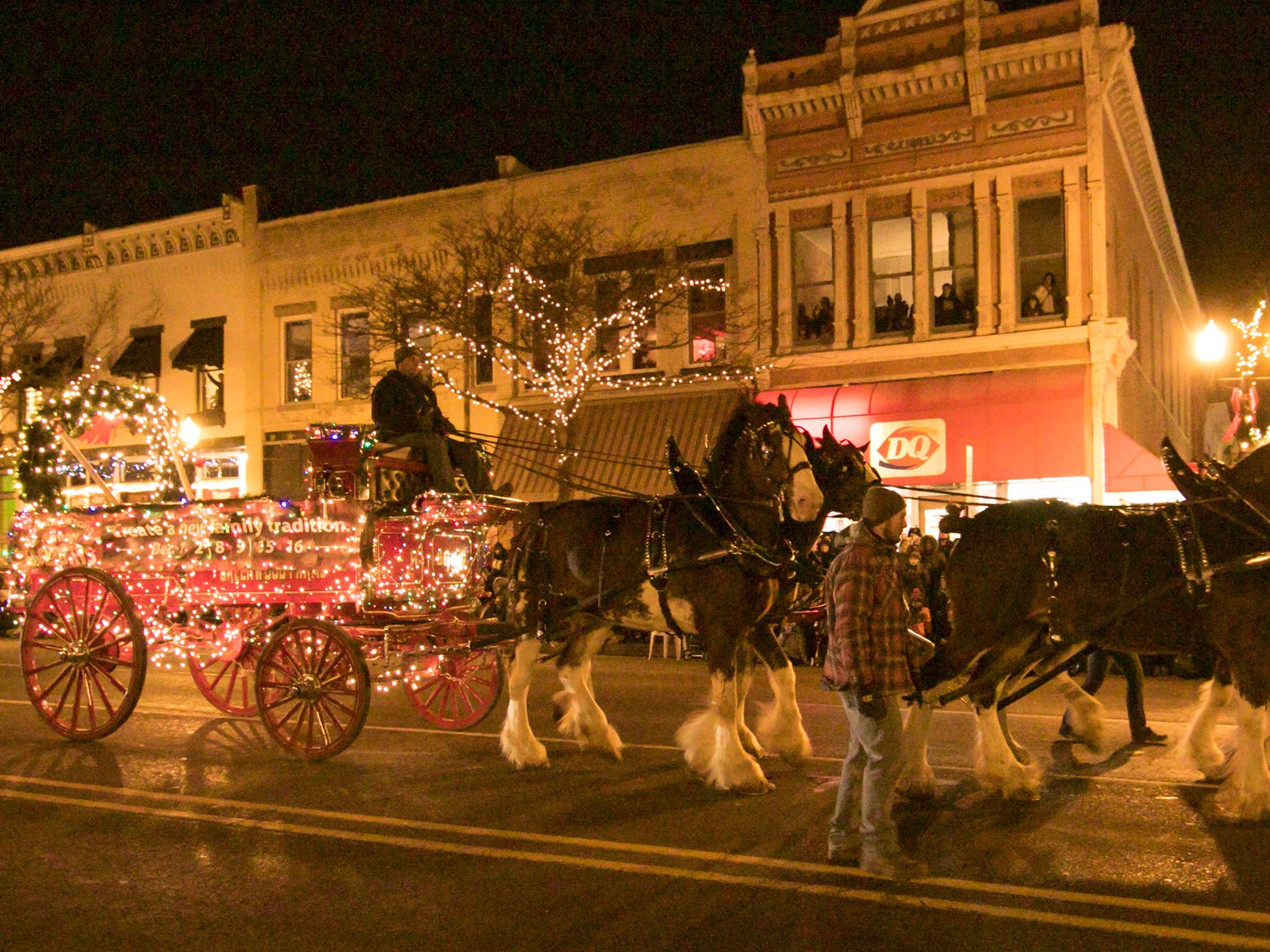 The Wolcott Mill Metropark float is pulled by a team of Clydesdale horses in the Fantasy of Lights parade Friday, Nov. 23, 2018.