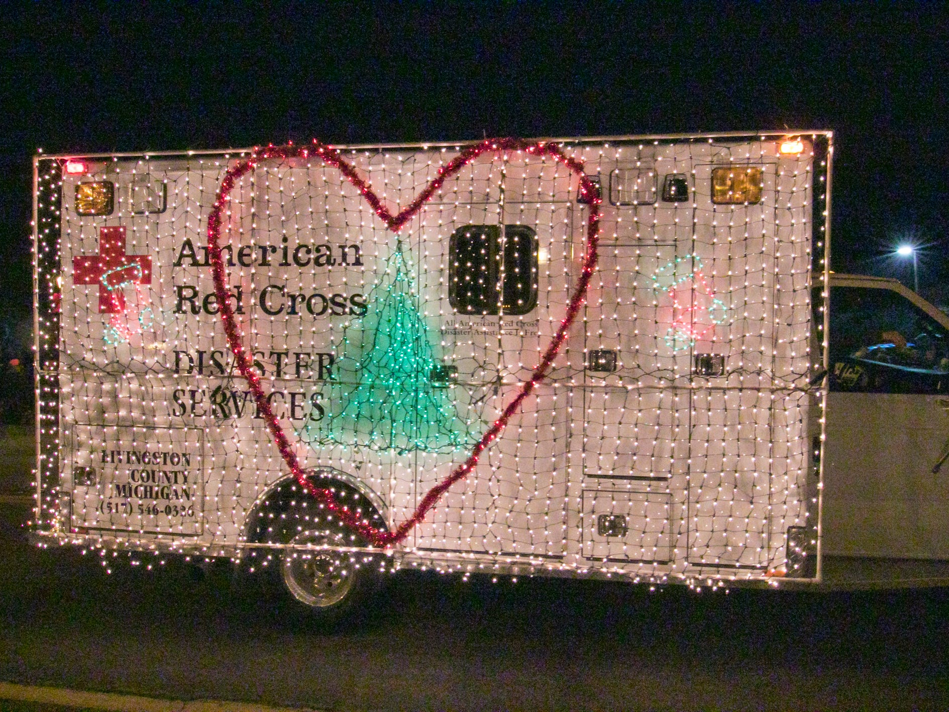 A float from the American Red Cross moves down Grand River in the Fantasy of Lights parade Friday, Nov. 23, 2018.