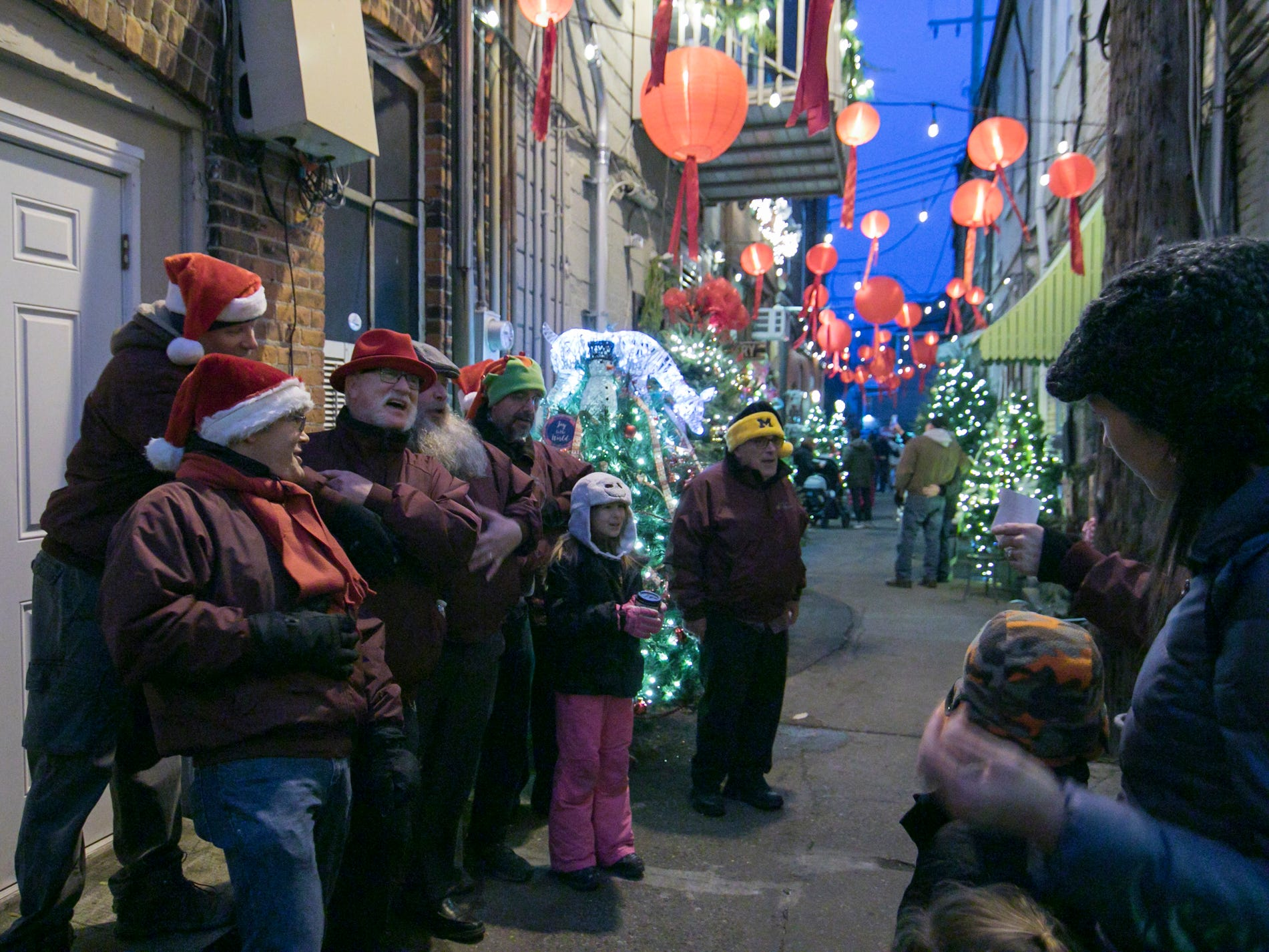 """The Livingston Lamplighters sing """"Rubber Ducky"""" in Peanut Row as part of the Fantasy of Lights event in Howell Friday, Nov. 23, 2018."""