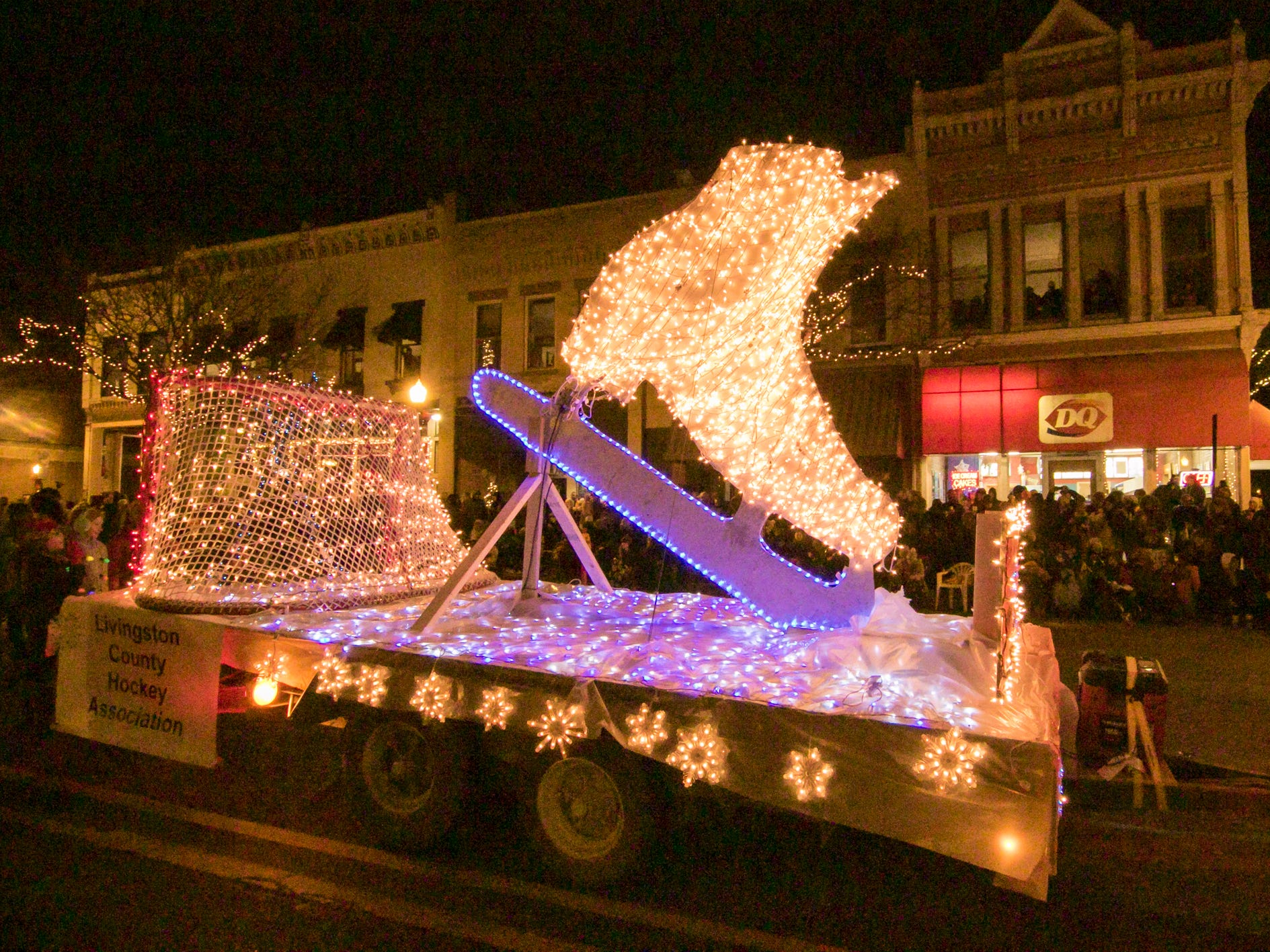 The float from the Livingston County Skate Club and Livingston County Hockey Association glides down Grand River in the Fantasy of Lights parade Friday, Nov. 23, 2018.