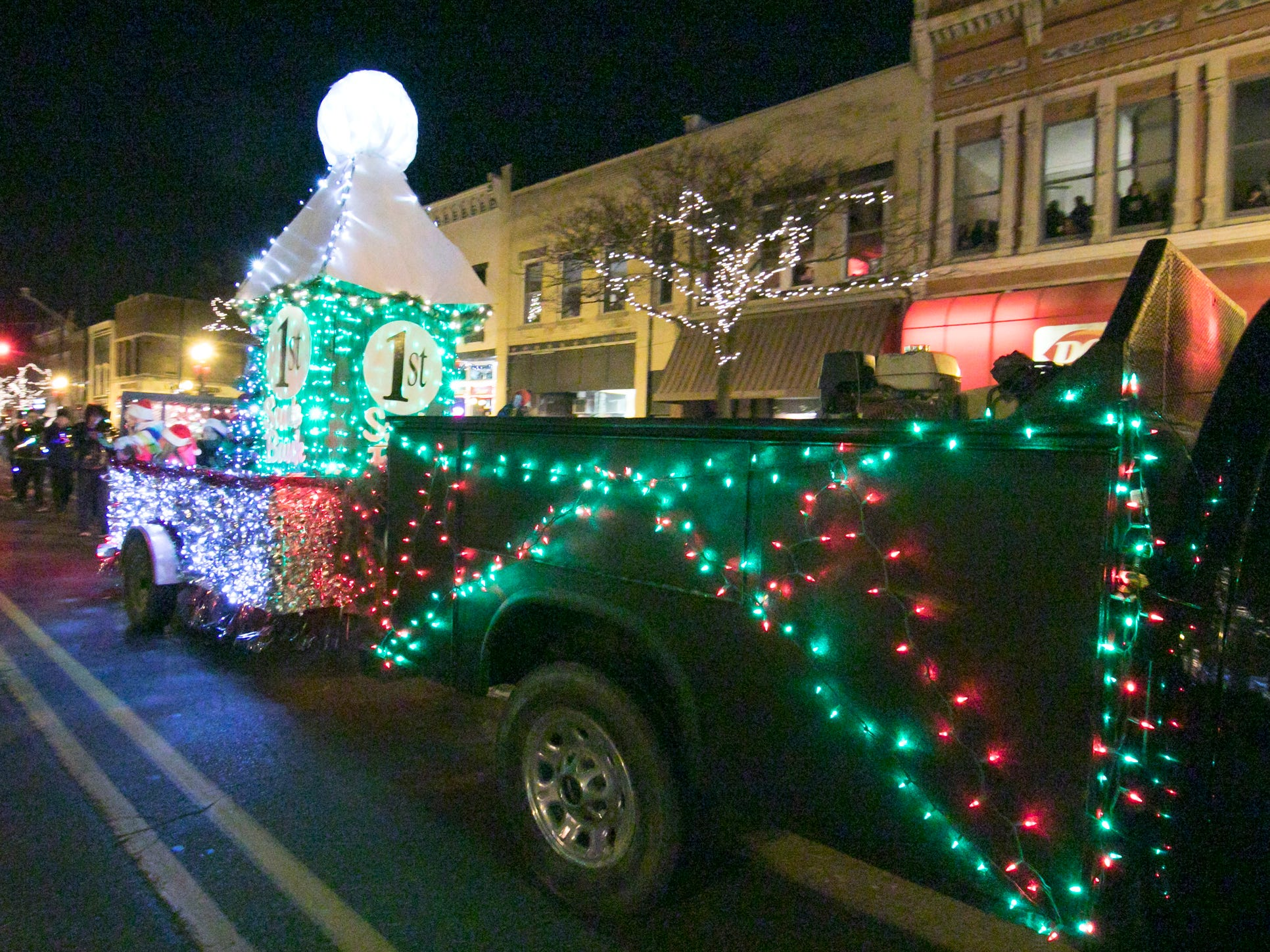 The First National Bank float rides in the Fantasy of Lights parade Friday, Nov. 23, 2018.