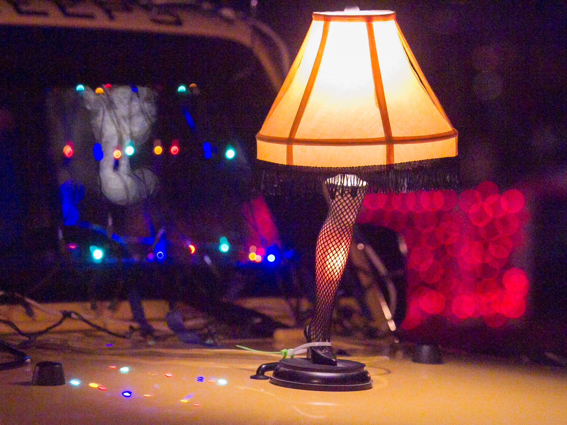 """One of a number of vehicles being honored the Most Unique award in the Fantasy of Lights parade Friday, Nov. 23, 2018 is adorned with a lamp inspired by the movie """"Christmas Story."""""""