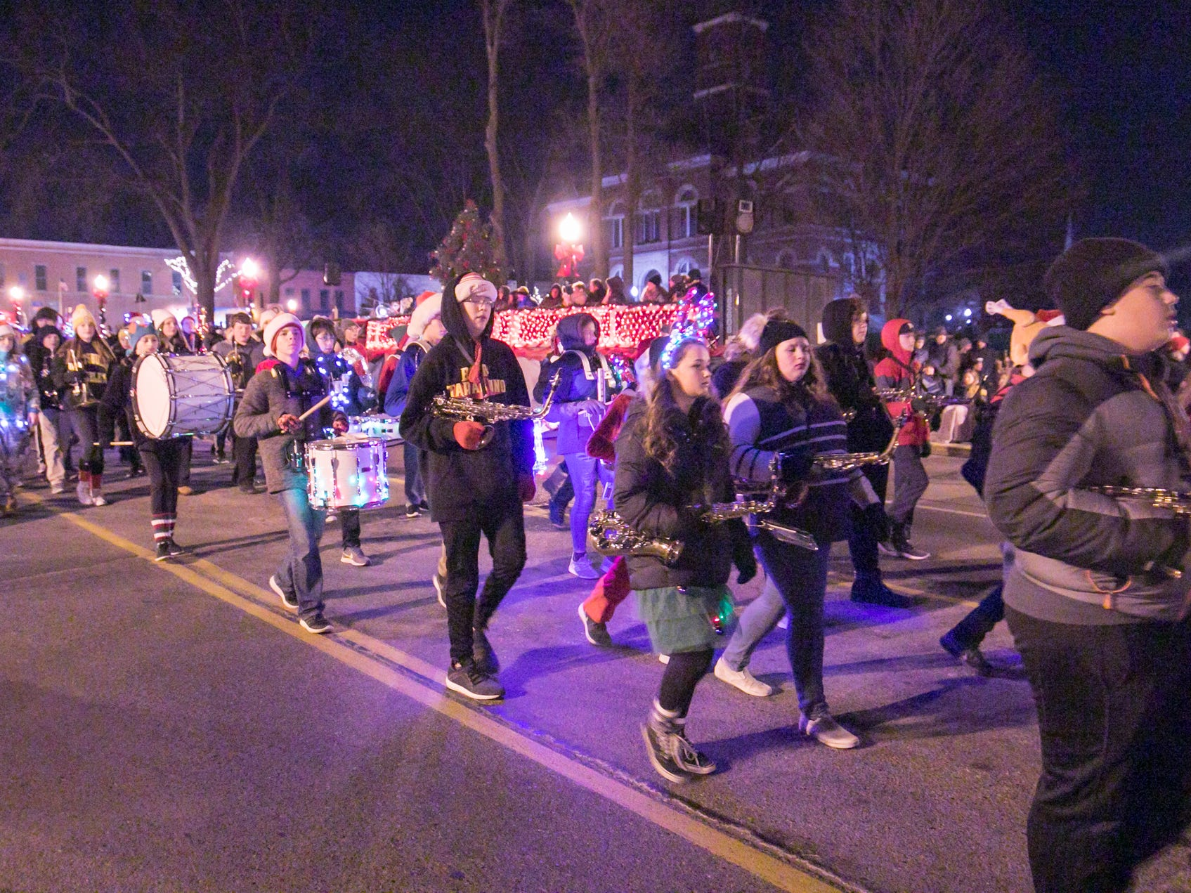The Parker Middle School marching band proceeds down the Fantasy of Lights parade route Friday, Nov. 23, 2018.