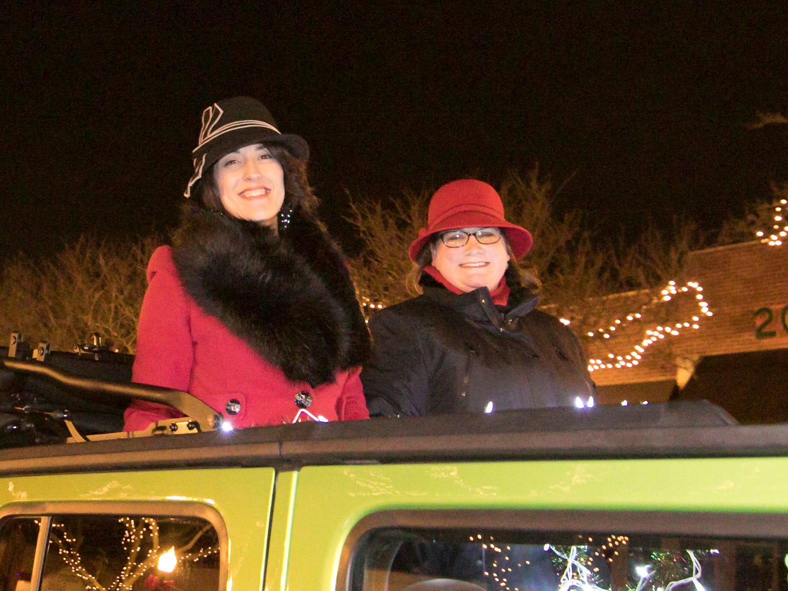 Howell Main Street director Cathleen Edgerly, left, and outreach coordinator Kate Litwin, grand marshals of the Fantasy of Lights parade, ride in a Jeep Friday, Nov. 23, 2018.