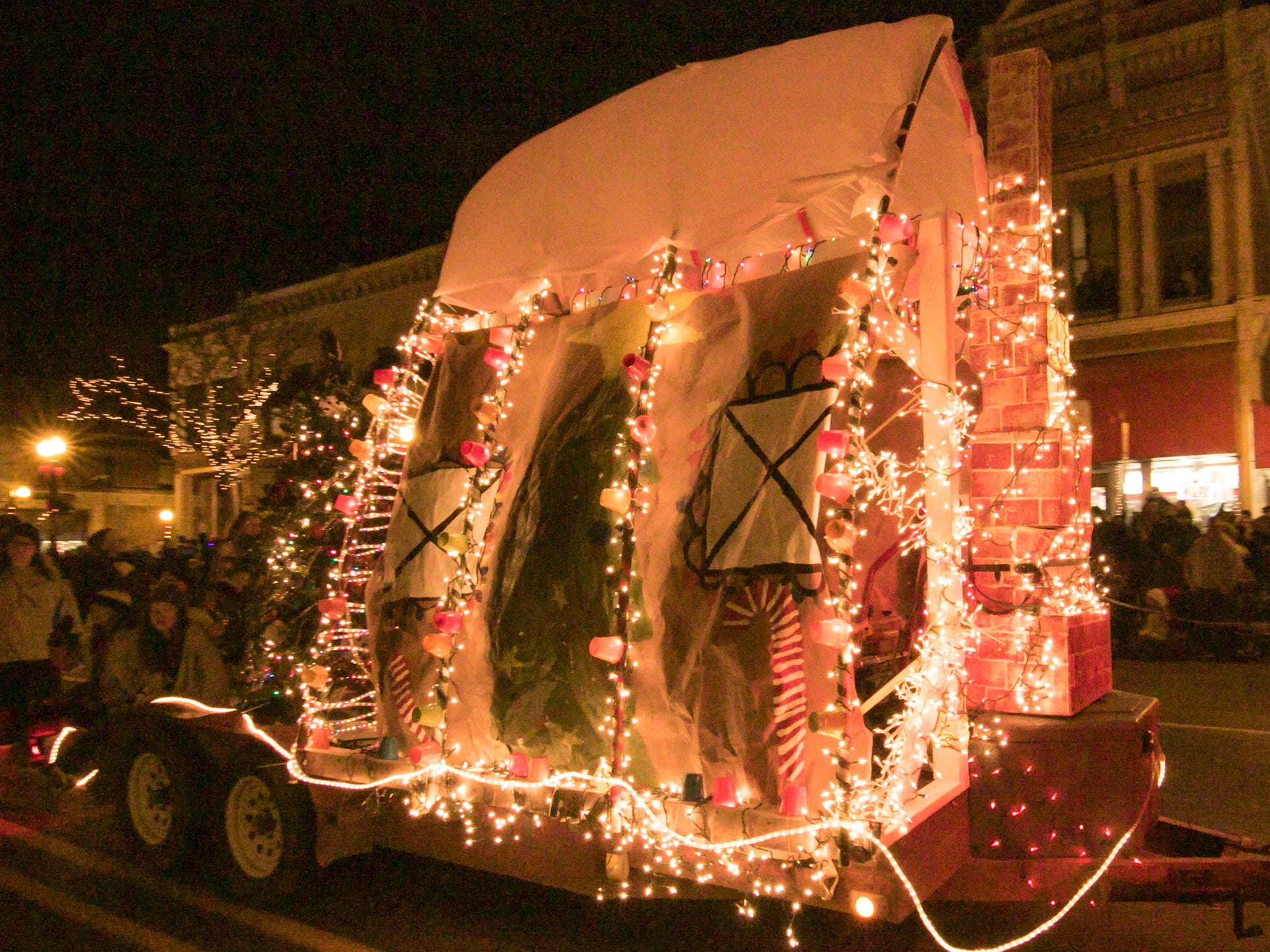A float provided by Kensington Woods Schools moves down Grand River in the Fantasy of Lights parade Friday, Nov. 23, 2018.